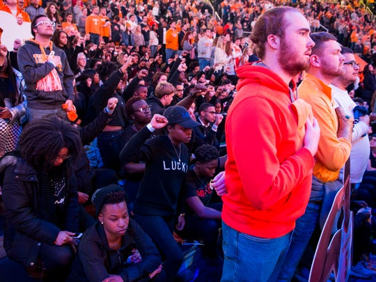 Students protest during the National Anthem before Tennessee's home finale against Mississippi State at Thompson-Boling Arena in Knoxville on Tuesday, March 5, 2019.