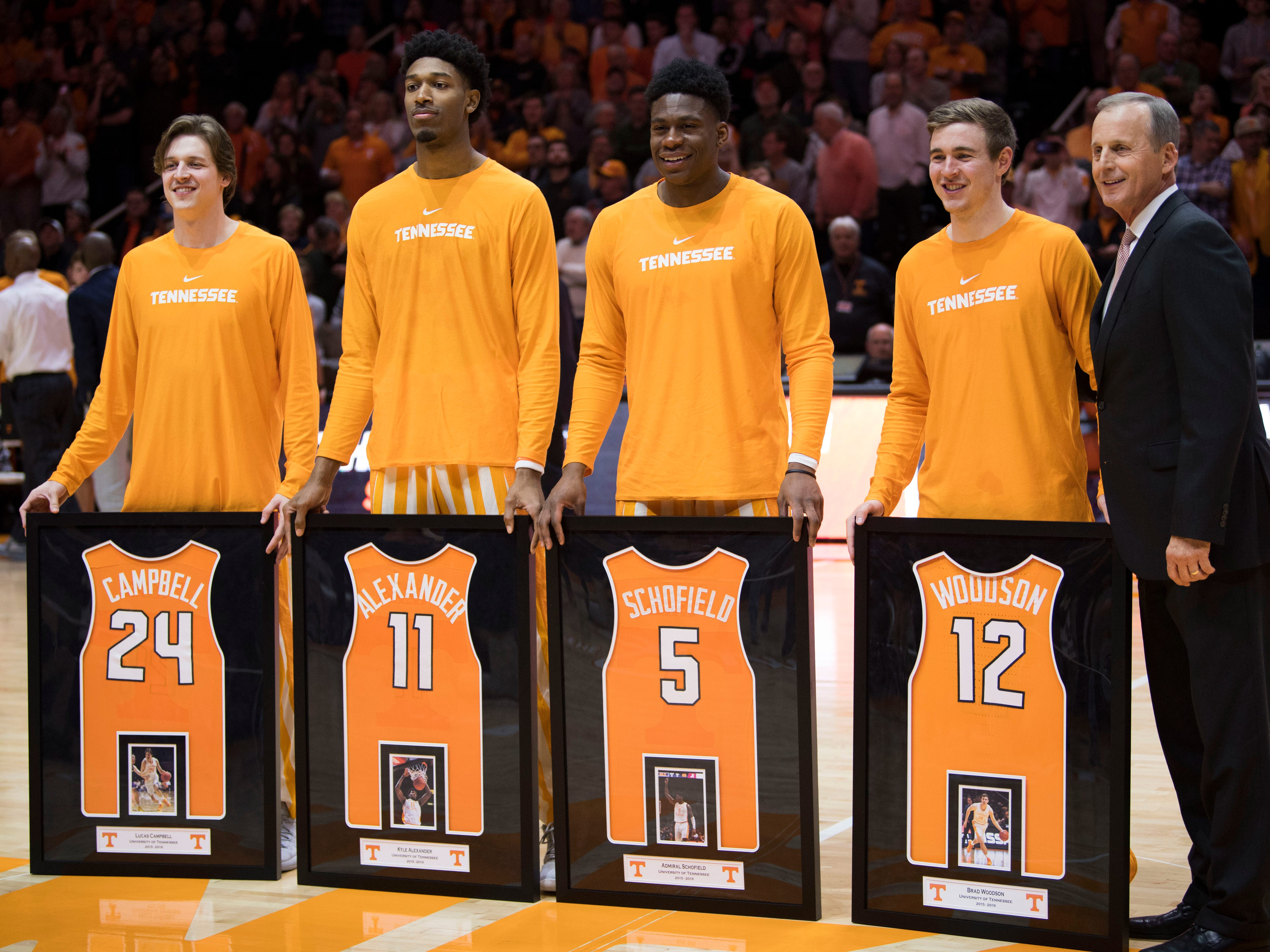 From left, Tennessee guard Lucas Campbell (24), Tennessee forward Kyle Alexander (11), Tennessee guard Admiral Schofield (5) and Tennessee guard Brad Woodson (12) is recognized during Senior Night before Tennessee's home finale against Mississippi State at Thompson-Boling Arena in Knoxville on Tuesday, March 5, 2019.