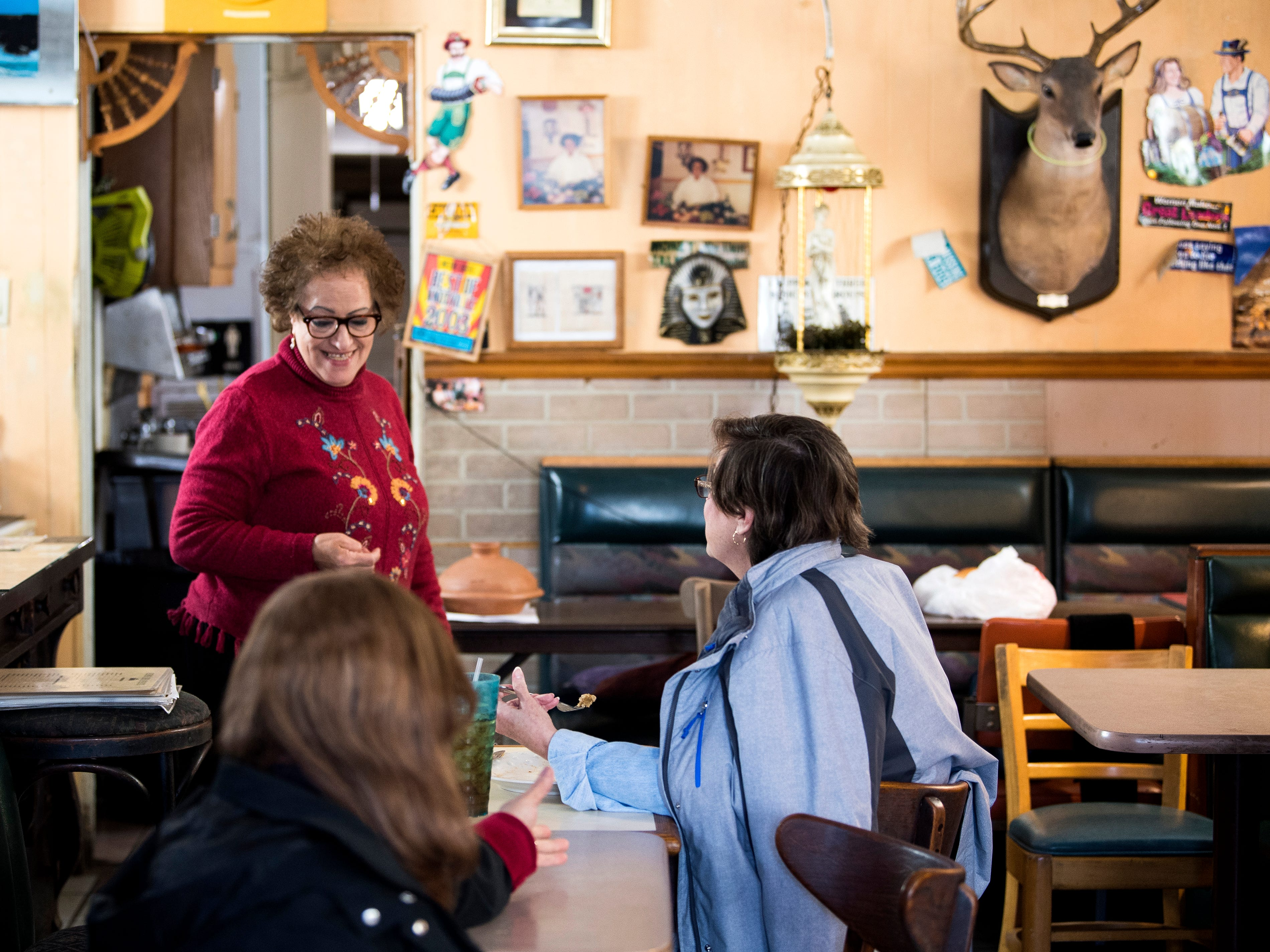 King Tut Grill owner Seham Girgis, left, checks on a customer at her South Knoxville restaurant on Wednesday, February 13, 2019. After 30 years, the restaurant will close in part because of an utility upgrade required by KUB that the restaurant cannot afford.