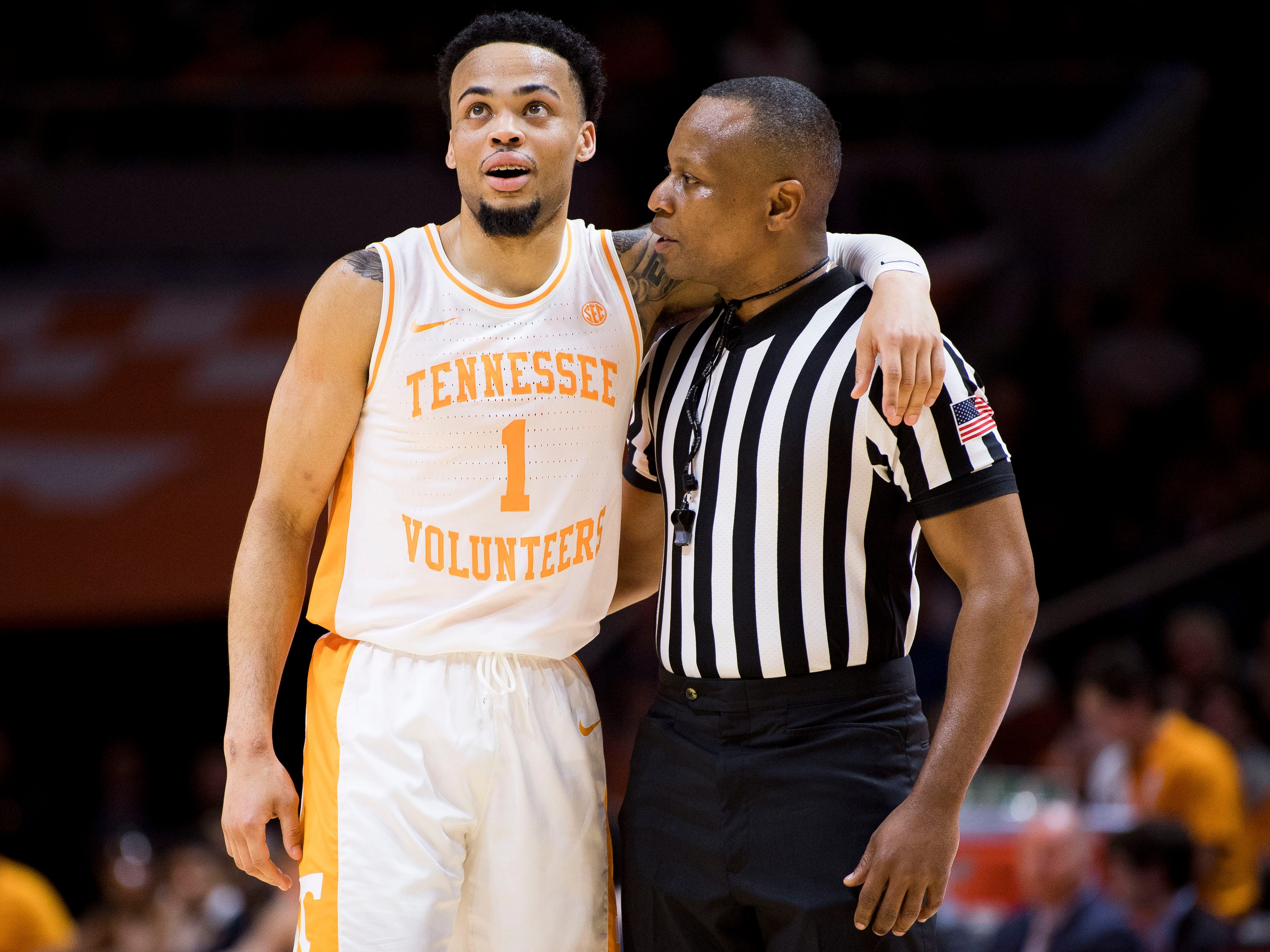Tennessee guard Lamonte Turner (1) chats with a referee after a foul was called against Turner during Tennessee's home finale against Mississippi State at Thompson-Boling Arena in Knoxville on Tuesday, March 5, 2019.