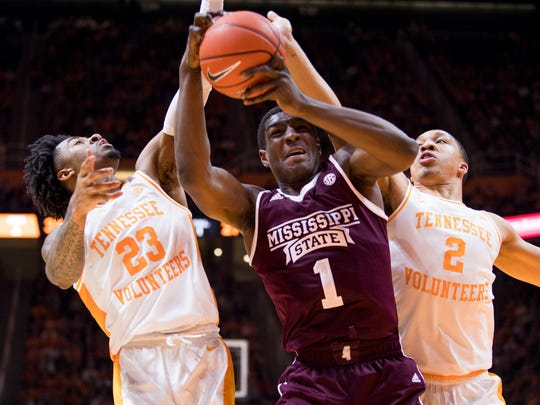 Tennessee guard Jordan Bowden (23) and Tennessee forward Grant Williams (2) defend Mississippi State forward Reggie Perry (1) during Tennessee's home finale against Mississippi State at Thompson-Boling Arena in Knoxville on Tuesday, March 5, 2019.