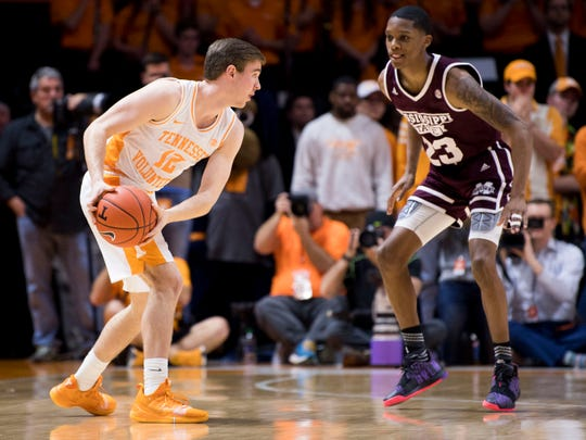 Tennessee guard Brad Woodson (12) looks to move past Mississippi State guard Tyson Carter (23) during Tennessee's home finale against Mississippi State at Thompson-Boling Arena in Knoxville on Tuesday, March 5, 2019.