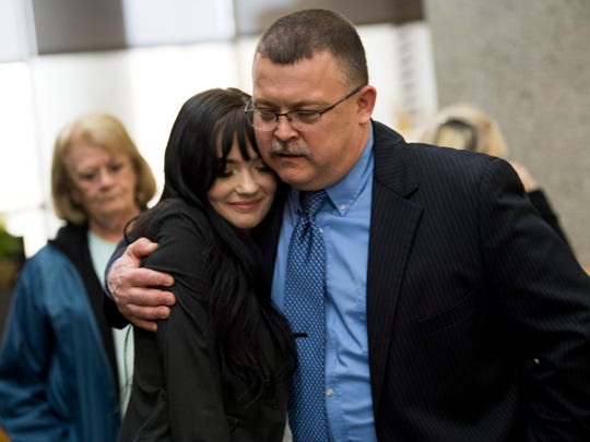 Amber Richards hugs and thanks KCSO lead investigator Allen Merritt outside of Knox County Criminal Court on Monday, February 11, 2019. A jury found David Lynn Richards guilty of nine felony counts, including rape, incest and sexual battery.
