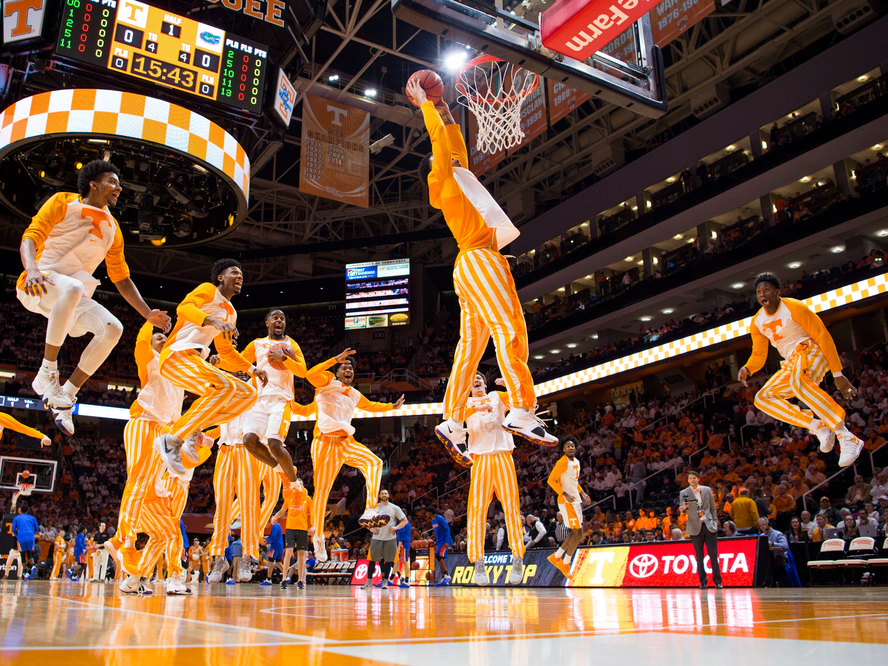 """Tennessee guard Lamonte Turner (1) dunks the ball for the team's """"One Fly, We All Fly"""" pregame tradition before Tennessee's home SEC conference game against Florida at Thompson-Boling Arena in Knoxville on Saturday, February 9, 2019."""