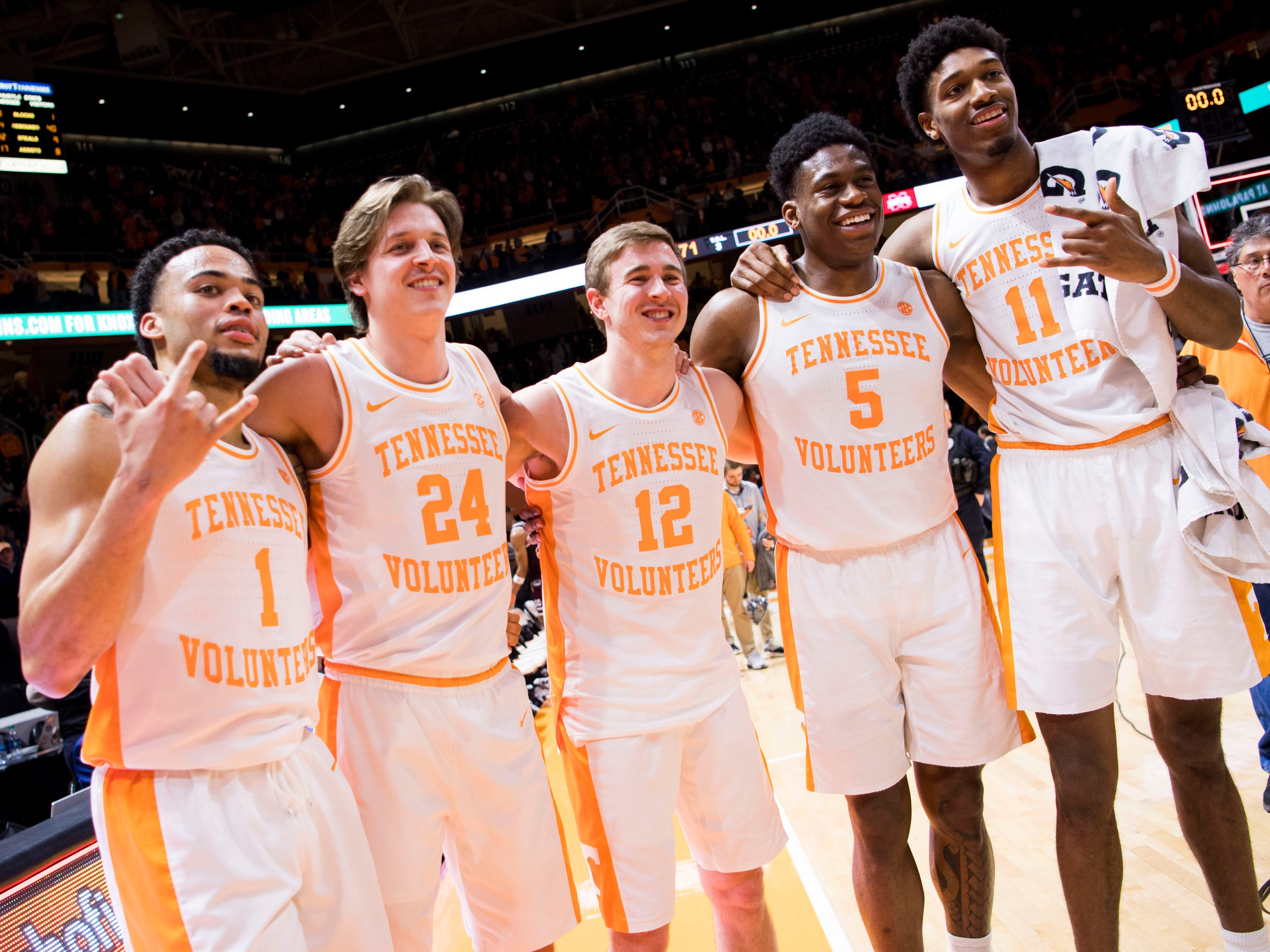 From left, Tennessee guard Lamonte Turner (1), Tennessee guard Lucas Campbell (24), Tennessee guard Brad Woodson (12), Tennessee guard Admiral Schofield (5) and Tennessee forward Kyle Alexander (11) after Tennessee's home finale against Mississippi State at Thompson-Boling Arena in Knoxville on Tuesday, March 5, 2019.