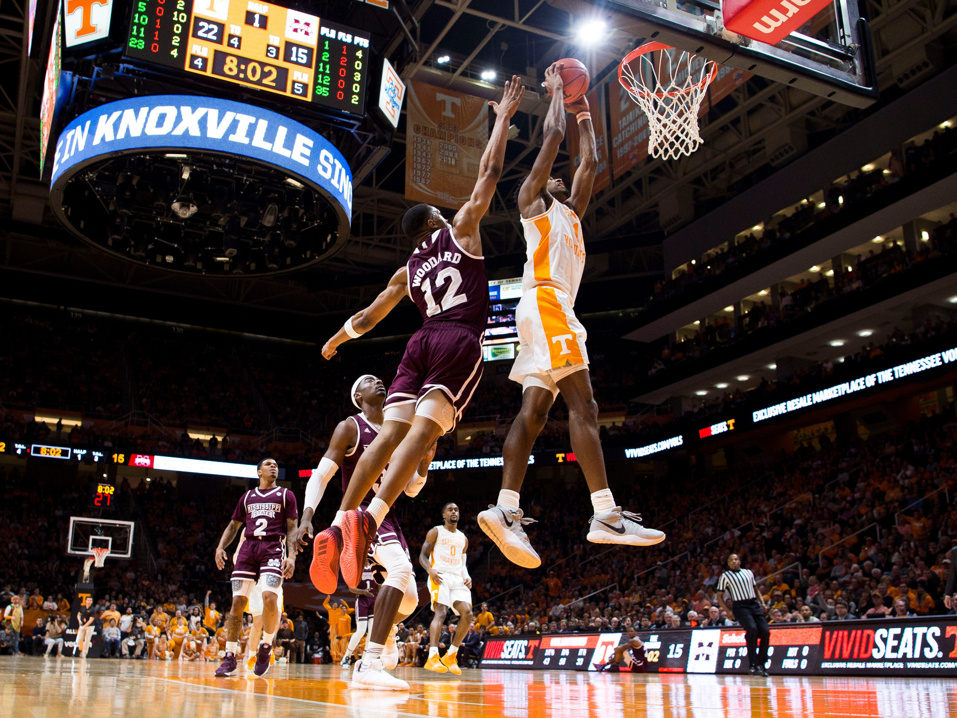 Tennessee forward Kyle Alexander (11) makes a dunk during Tennessee's home finale against Mississippi State at Thompson-Boling Arena in Knoxville on Tuesday, March 5, 2019.
