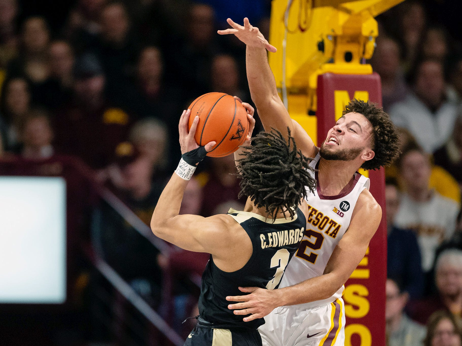 Mar 5, 2019; Minneapolis, MN, USA; Minnesota Gophers guard Gabe Kalscheur (22) blocks Purdue Boilermakers guard Carsen Edwards (3) shot during the first half at Williams Arena. Mandatory Credit: Harrison Barden-USA TODAY Sports