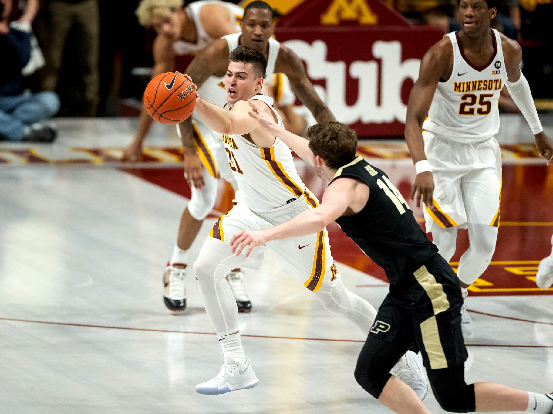 Mar 5, 2019; Minneapolis, MN, USA; Minnesota Gophers guard Brock Stull (31) and Purdue Boilermakers guard Ryan Cline (14) fight for the ball during the first half at Williams Arena. Mandatory Credit: Harrison Barden-USA TODAY Sports