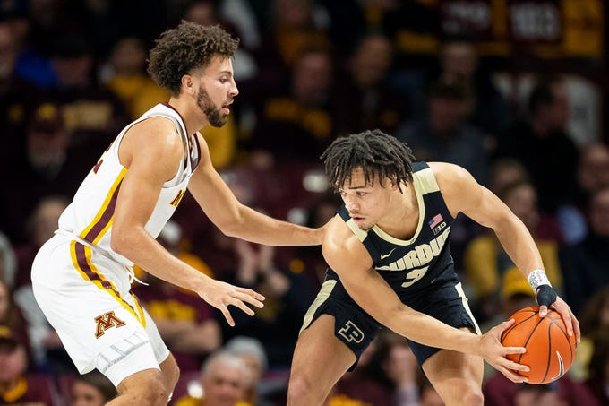 Mar 5, 2019; Minneapolis, MN, USA; Purdue Boilermakers guard Carsen Edwards (3) dribbles the ball as Minnesota Gophers guard Gabe Kalscheur (22) defends during the first half at Williams Arena. Mandatory Credit: Harrison Barden-USA TODAY Sports