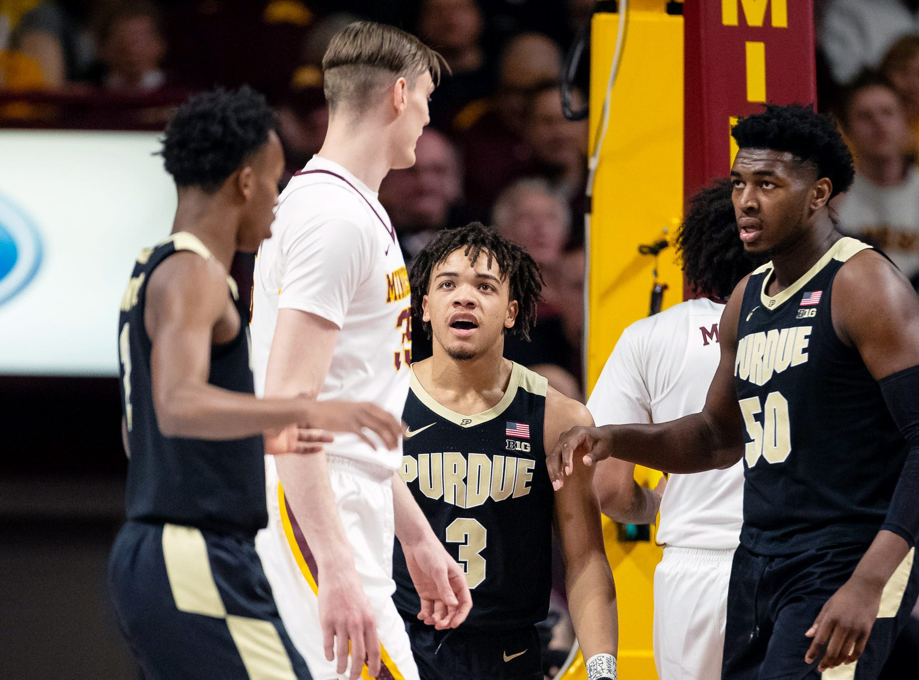 Mar 5, 2019; Minneapolis, MN, USA; Purdue Boilermakers guard Carsen Edwards (3) and Minnesota Gophers center Matz Stockman (35) exchange words during the first half at Williams Arena. Mandatory Credit: Harrison Barden-USA TODAY Sports