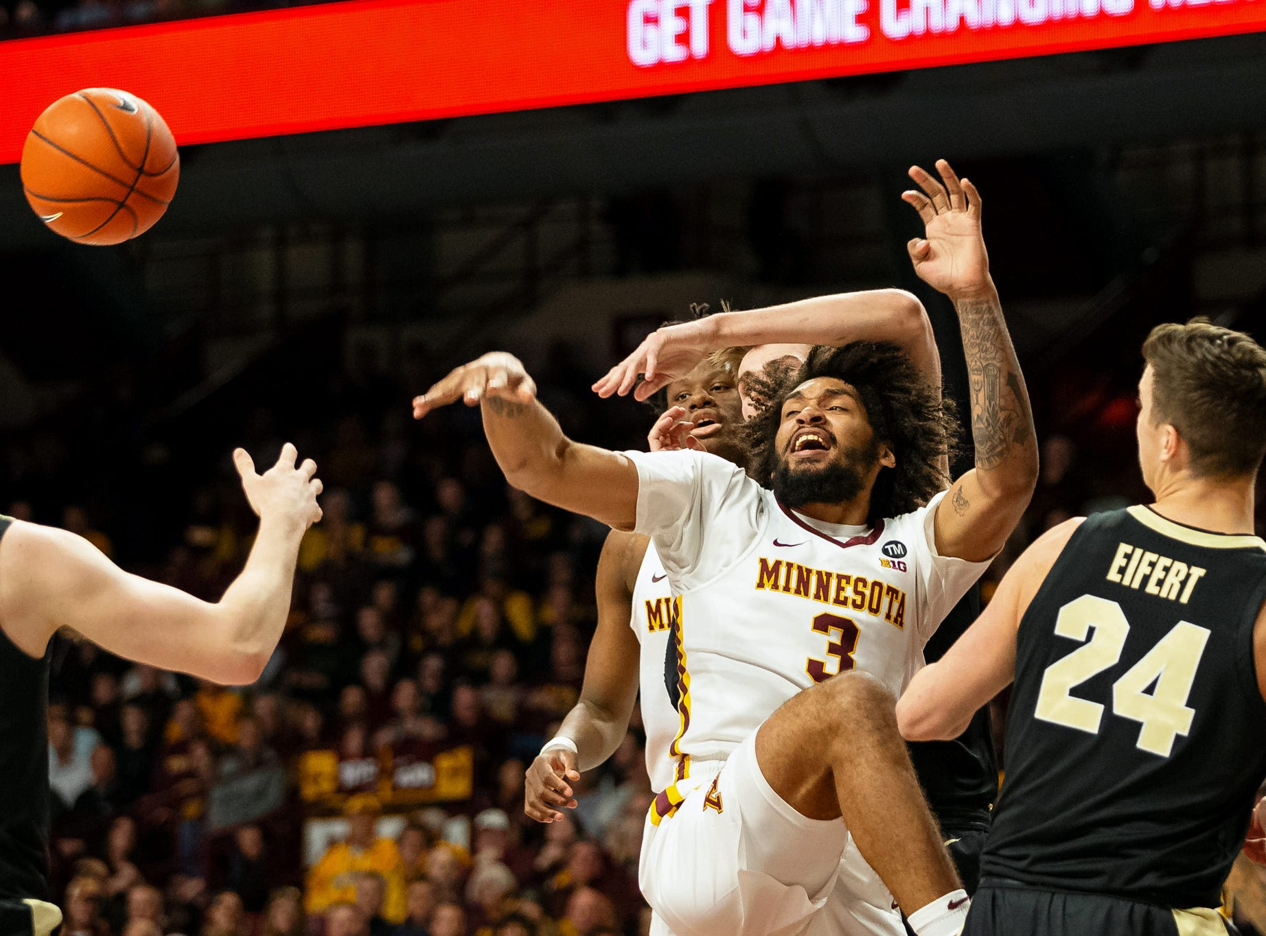 Mar 5, 2019; Minneapolis, MN, USA; Minnesota Gophers forward Jordan Murphy (3) shot is broken up during the first half against the Purdue Boilermakers at Williams Arena. Mandatory Credit: Harrison Barden-USA TODAY Sports