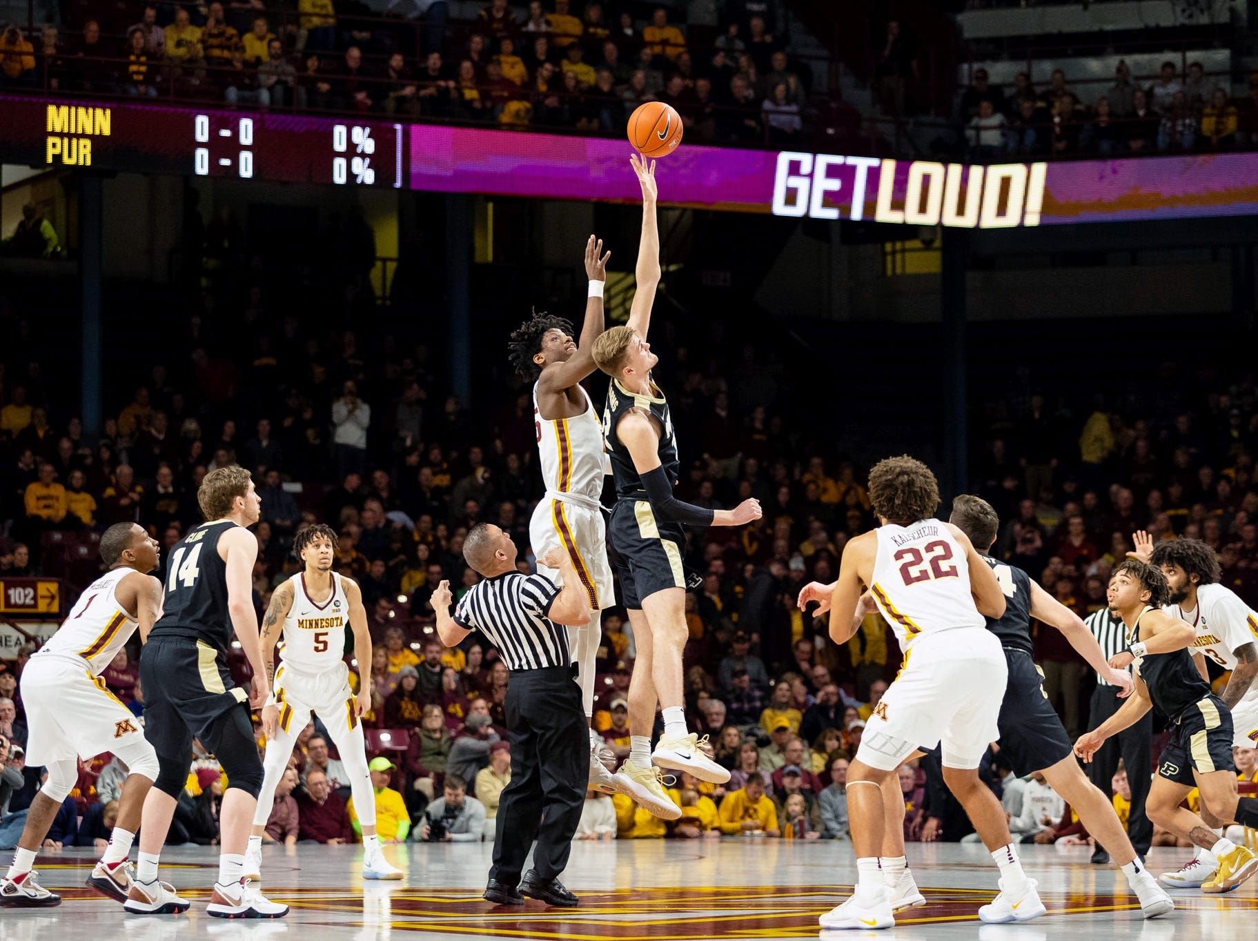 Mar 5, 2019; Minneapolis, MN, USA; Minnesota Gophers center Daniel Oturu (25) and Purdue Boilermakers center Matt Haarms (32) jump for the ball during the first half at Williams Arena. Mandatory Credit: Harrison Barden-USA TODAY Sports