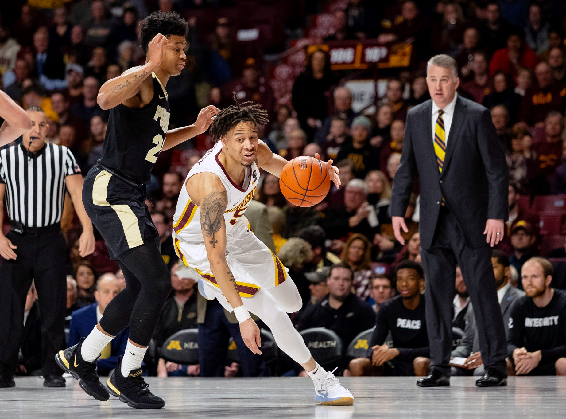 Mar 5, 2019; Minneapolis, MN, USA; Minnesota Gophers guard Amir Coffey (5) drives to the basket as Purdue Boilermakers guard Nojel Eastern (20) defends during the first half at Williams Arena. Mandatory Credit: Harrison Barden-USA TODAY Sports