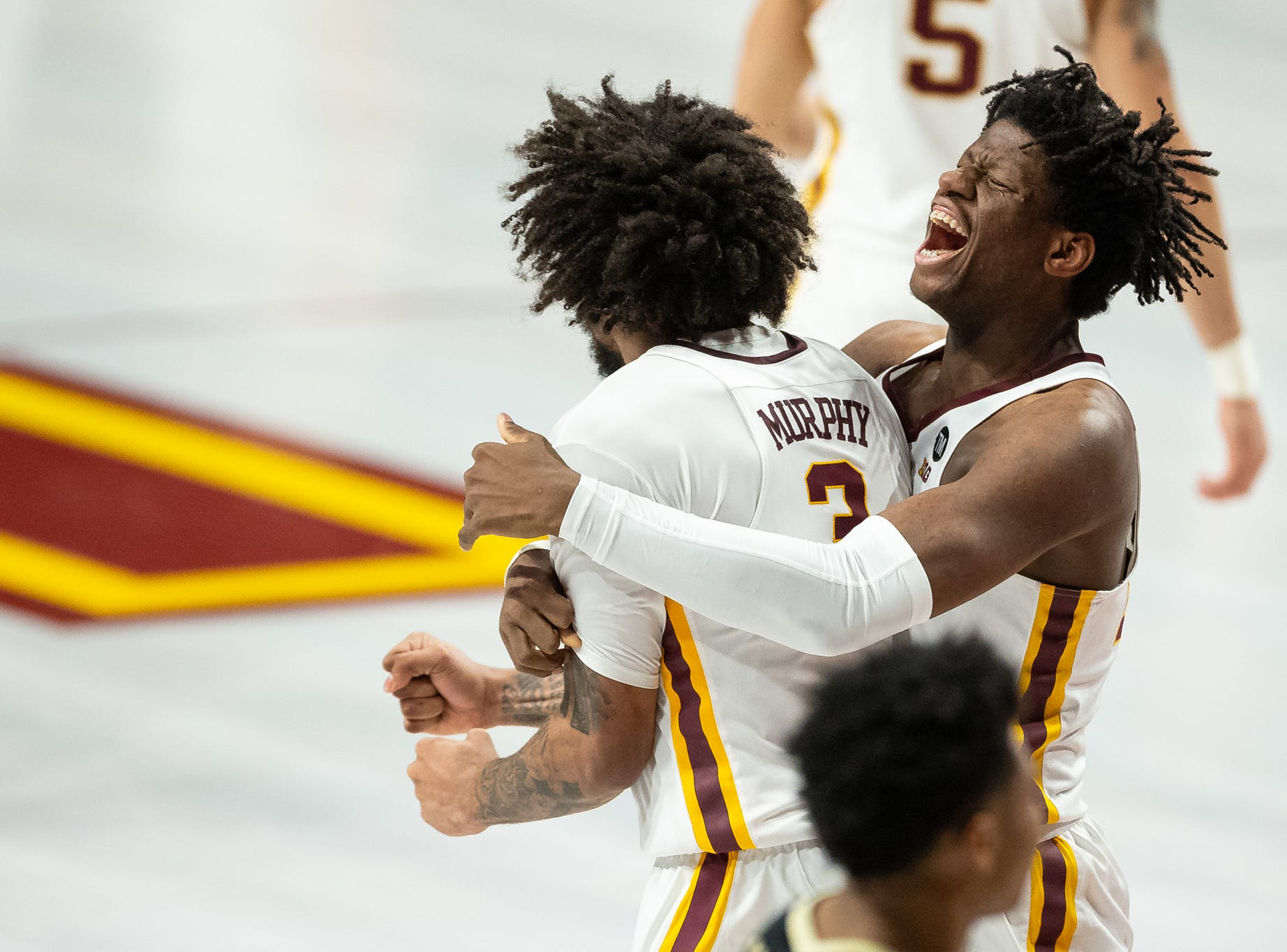 Mar 5, 2019; Minneapolis, MN, USA; Minnesota Gophers center Daniel Oturu (25) and forward Jordan Murphy (3) react after a play during the first half against the Purdue Boilermakers at Williams Arena. Mandatory Credit: Harrison Barden-USA TODAY Sports
