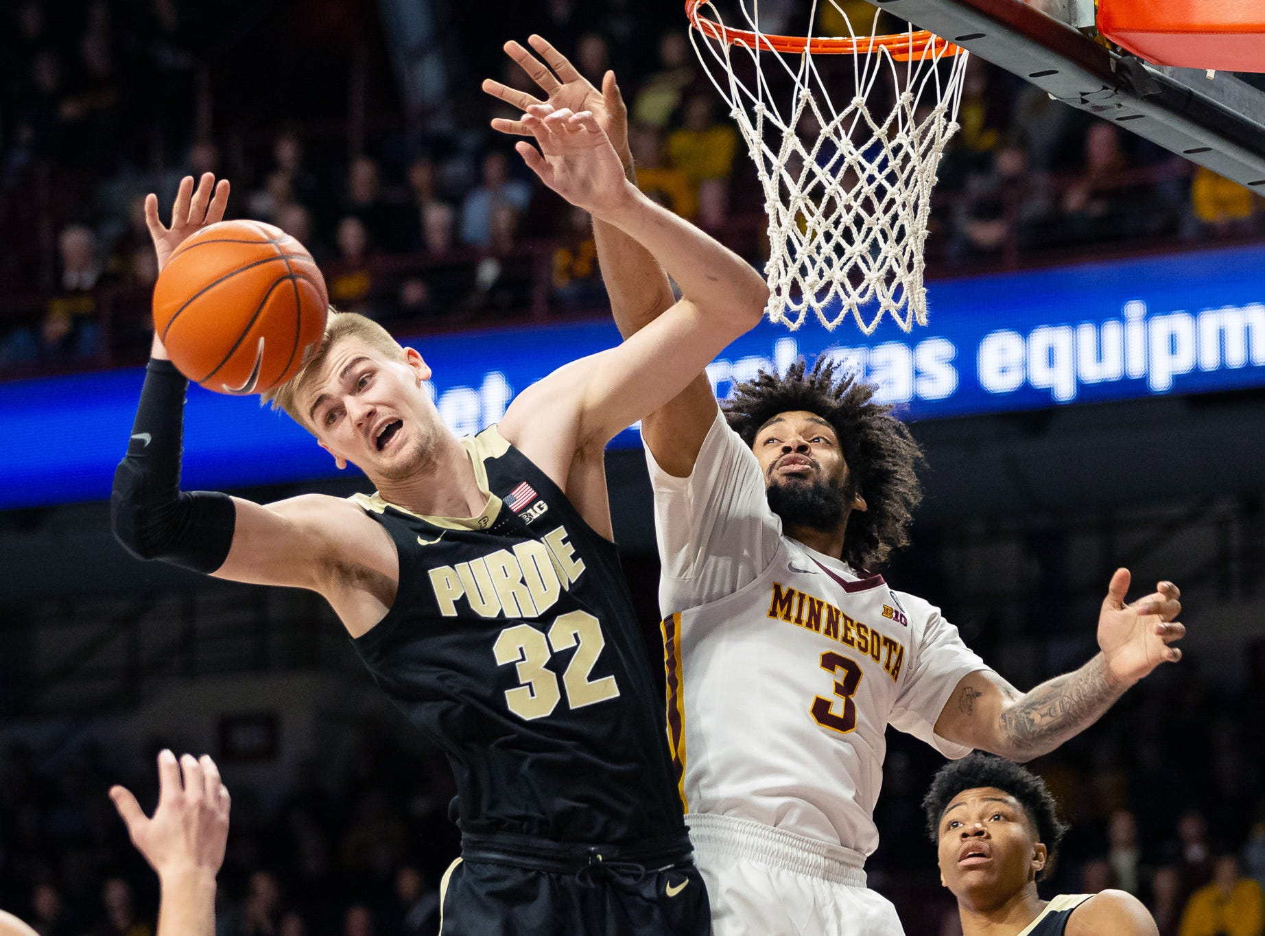 Mar 5, 2019; Minneapolis, MN, USA; Minnesota Gophers forward Jordan Murphy (3) and Purdue Boilermakers center Matt Haarms (32) fight for the ball during the first half at Williams Arena. Mandatory Credit: Harrison Barden-USA TODAY Sports