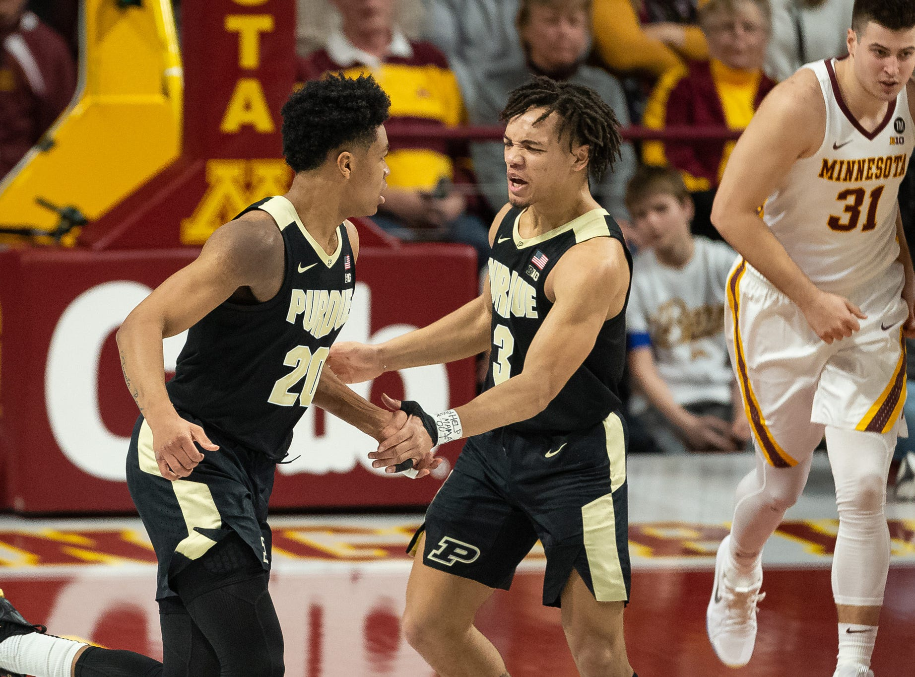 Mar 5, 2019; Minneapolis, MN, USA; Purdue Boilermakers guard Carsen Edwards (3) and guard Nojel Eastern (20) celebrate after a play during the first half against the Minnesota Gophers at Williams Arena. Mandatory Credit: Harrison Barden-USA TODAY Sports