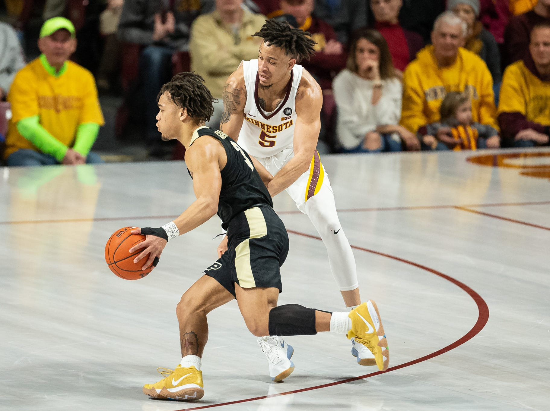 Mar 5, 2019; Minneapolis, MN, USA; Purdue Boilermakers guard Carsen Edwards (3) drives to the basket as Minnesota Gophers guard Amir Coffey (5) defends during the first half at Williams Arena. Mandatory Credit: Harrison Barden-USA TODAY Sports