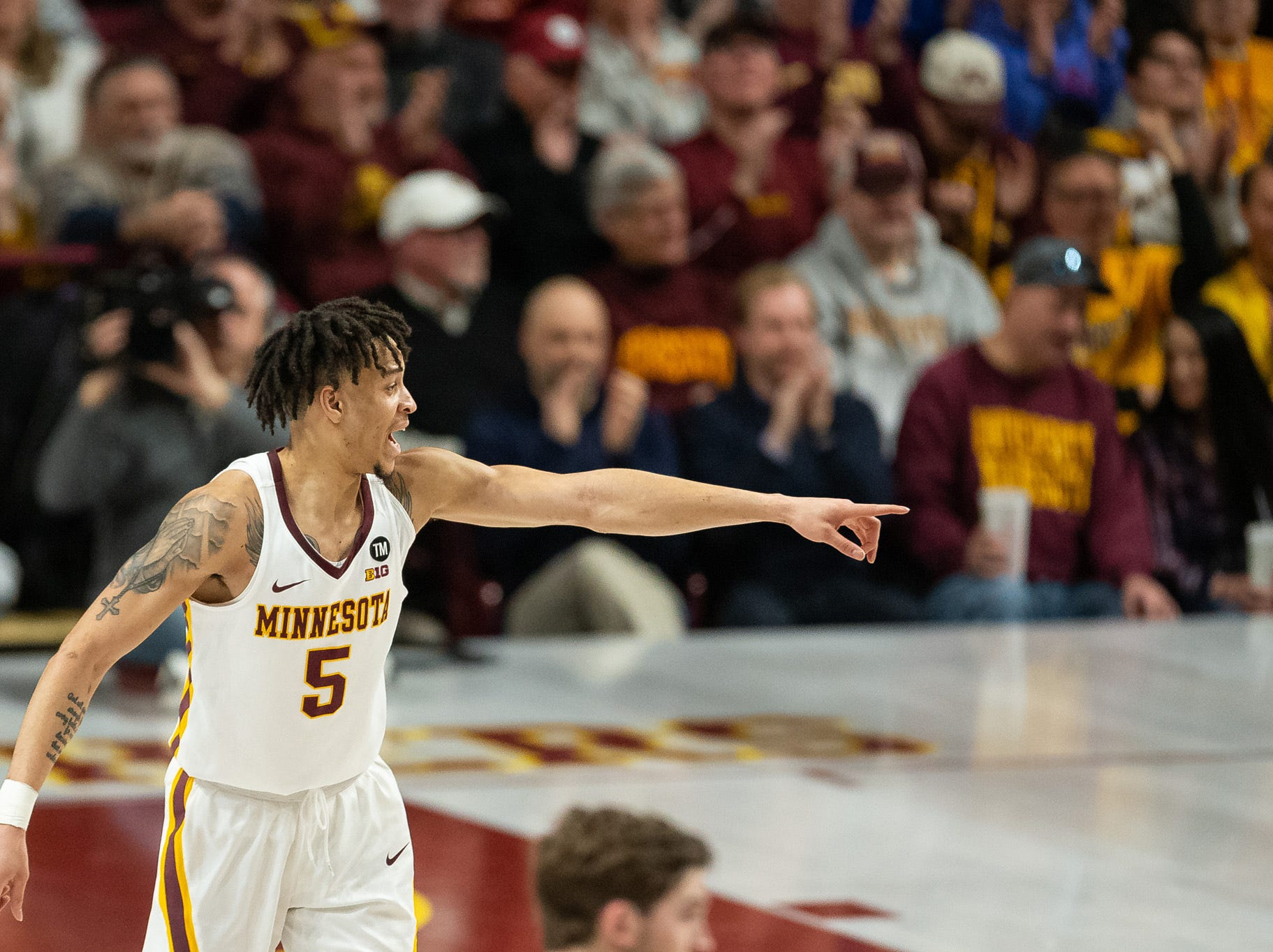 Mar 5, 2019; Minneapolis, MN, USA; Minnesota Gophers guard Amir Coffey (5) signals to a teammate during the first half against the Purdue Boilermakers at Williams Arena. Mandatory Credit: Harrison Barden-USA TODAY Sports