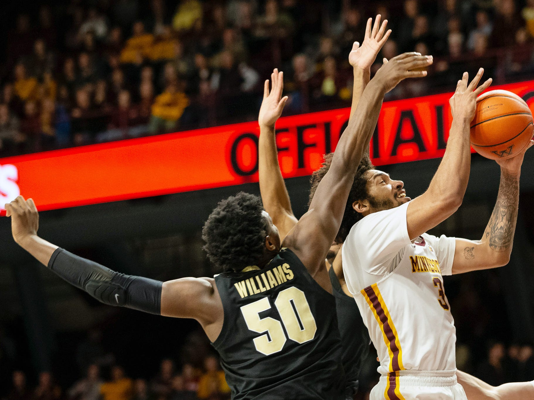 Mar 5, 2019; Minneapolis, MN, USA; Minnesota Gophers forward Jordan Murphy (3) drives to the basket as Purdue Boilermakers forward Trevion Williams (50) defends during the first half at Williams Arena. Mandatory Credit: Harrison Barden-USA TODAY Sports