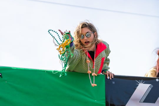 Float-riders throw beads to spectators as the Independent Parade rolls through downtown Lafayette on Mardi Gras Day, March 5, 2019.