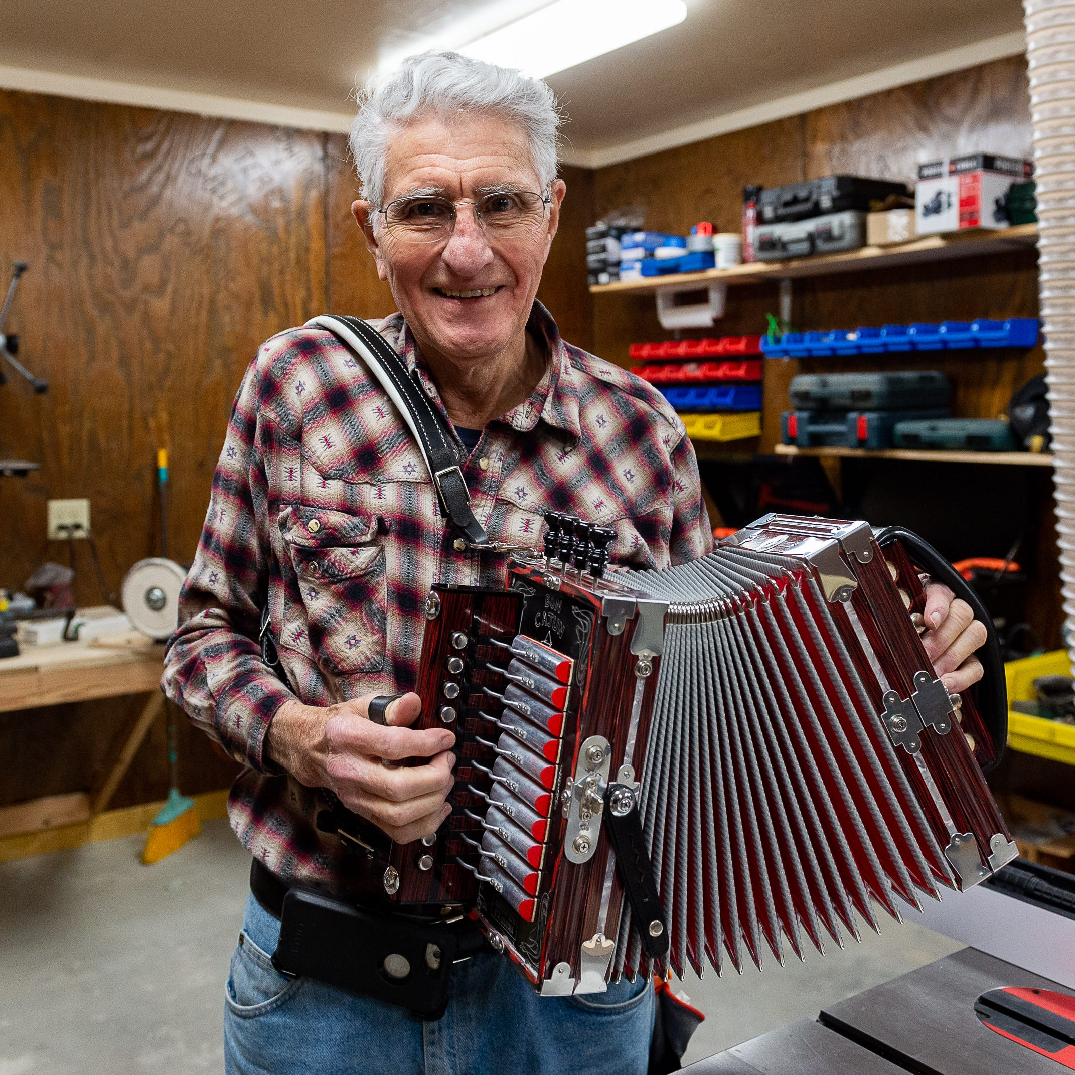 Accordion legend Larry Miller rebuilds shop using original Iota Mardi Gras dance floor