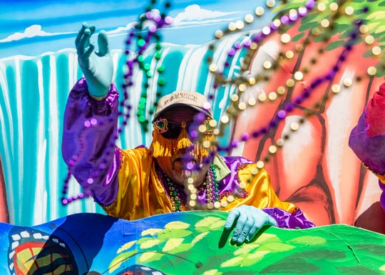 Float riders don costumes and throw beads to parade-goers as the King Gabriel Parade rolls through downtown Lafayette on Mardi Gras Day, March 5, 2019.