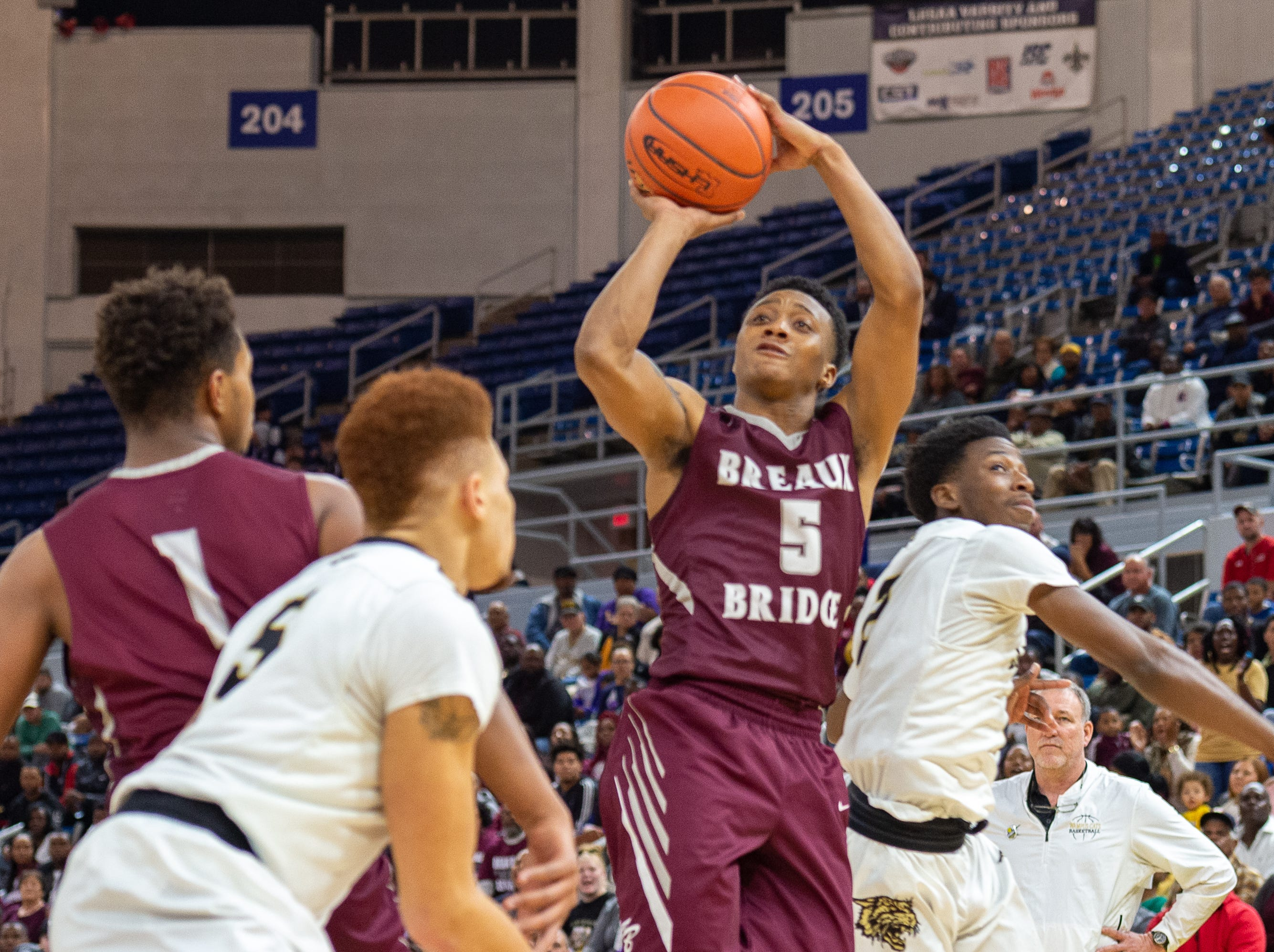 Dartravien Girod takes a shot as Breaux Bridge takes on Leesville in the semi final round of the LHSAA Basketball Championship Tournament. Tuesday, March 5, 2019.