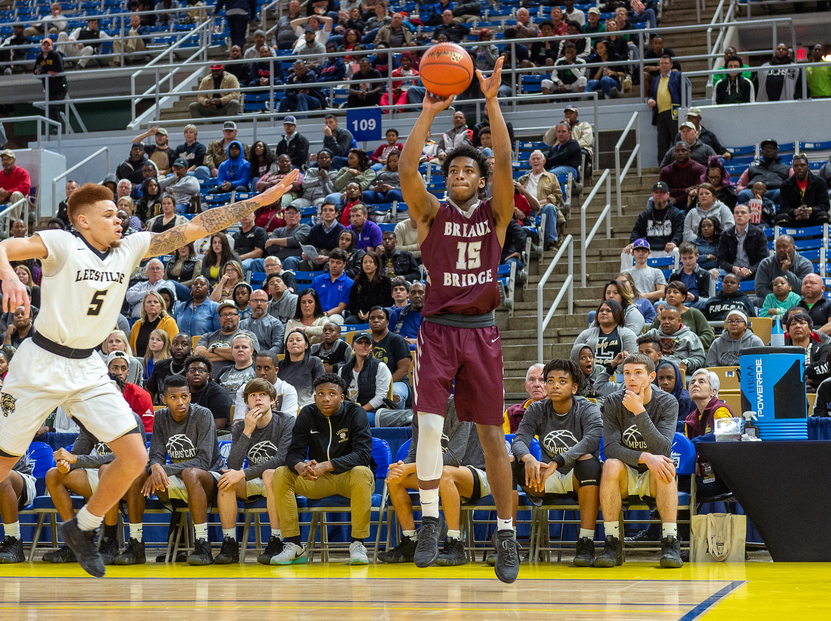 Kyser Patt shoots a three as Breaux Bridge takes on Leesville in the semi final round of the LHSAA Basketball Championship Tournament. Tuesday, March 5, 2019.
