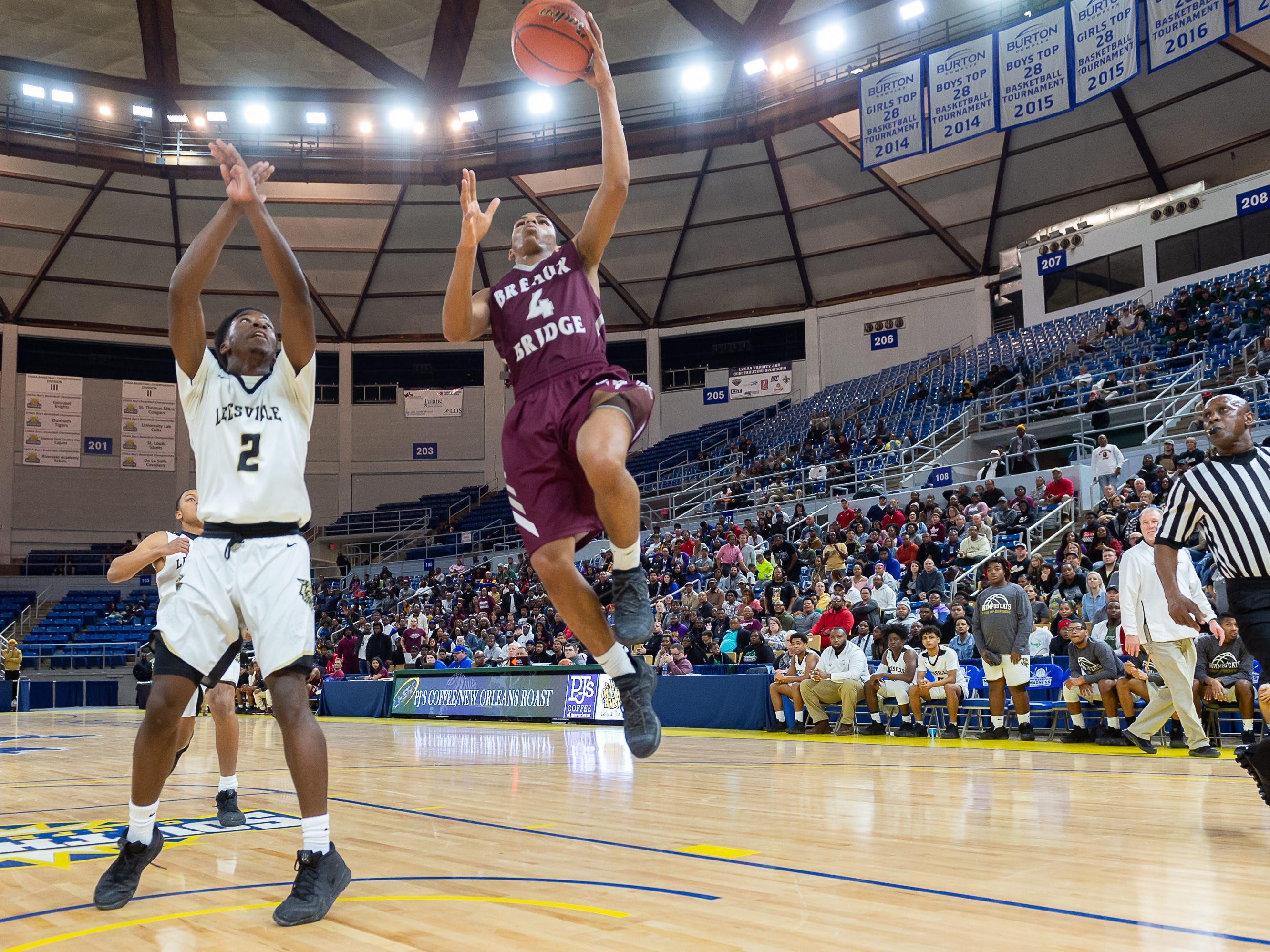 Dalton Alexander III drives to the basket as Breaux Bridge takes on Leesville in the semi final round of the LHSAA Basketball Championship Tournament. Tuesday, March 5, 2019.