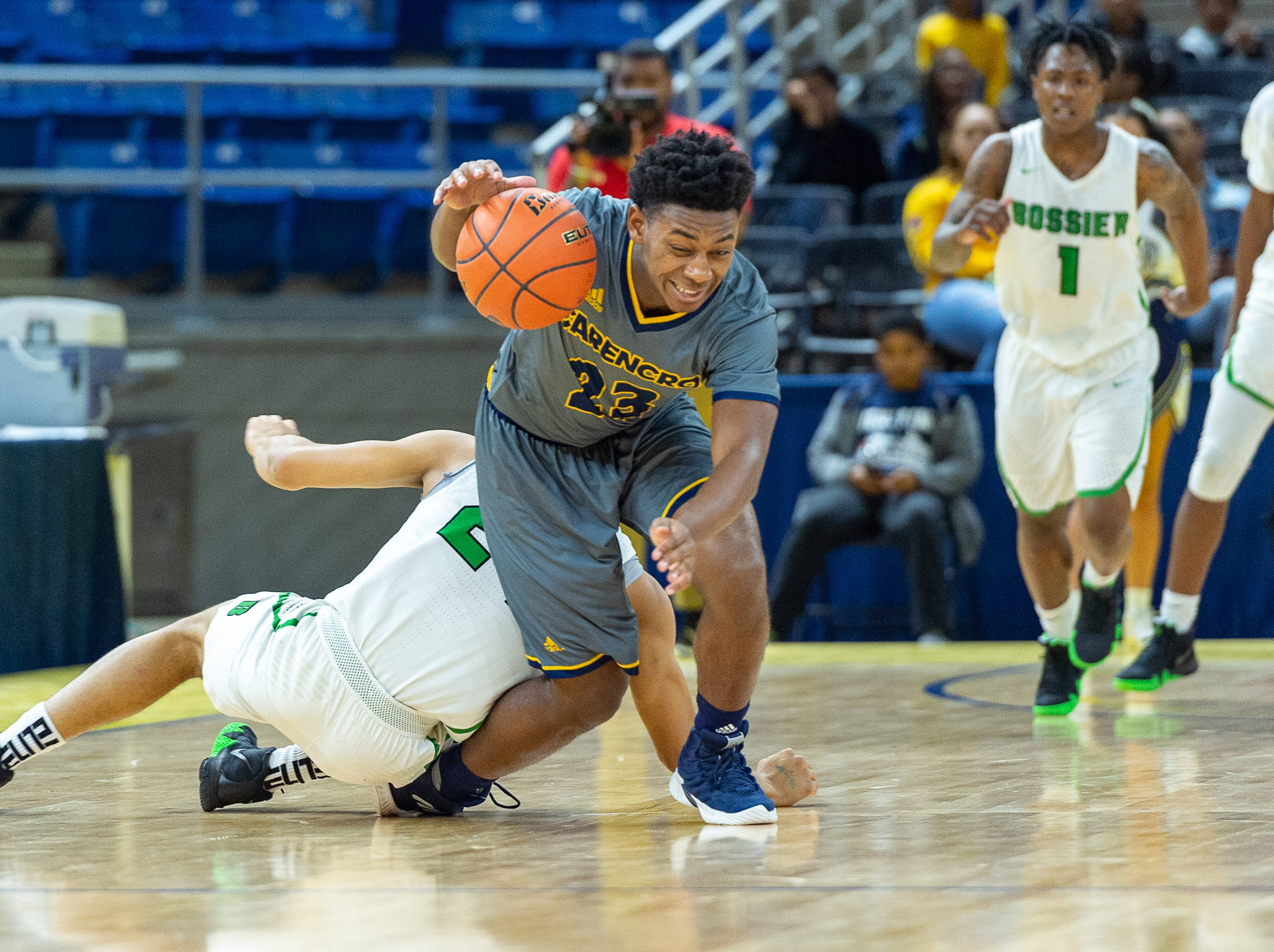 Lucas Williams is fouled as Carencro falls to Bossier in the Semi Final round of the LHSAA State Championships. Tuesday, March 5, 2019.