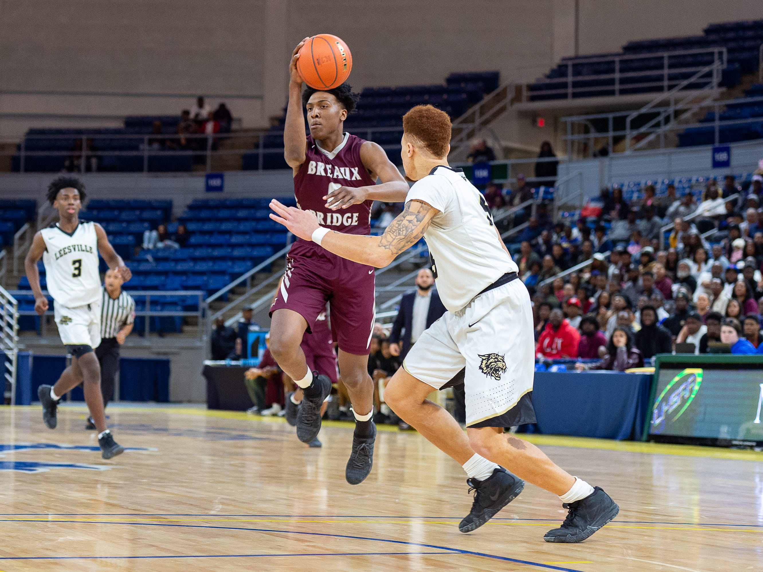 Deandre Hypolite drives to the basket as Breaux Bridge takes on Leesville in the semi final round of the LHSAA Basketball Championship Tournament. Tuesday, March 5, 2019.