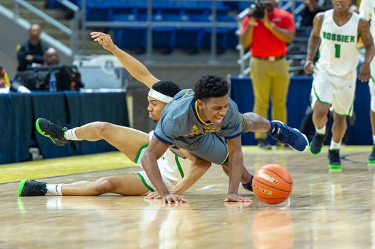 Carencro High's Lucas Williams is fouled as Carencro falls to Bossier in the semifinal round of the LHSAA Class 4A State Championships. Tuesday, March 5, 2019.