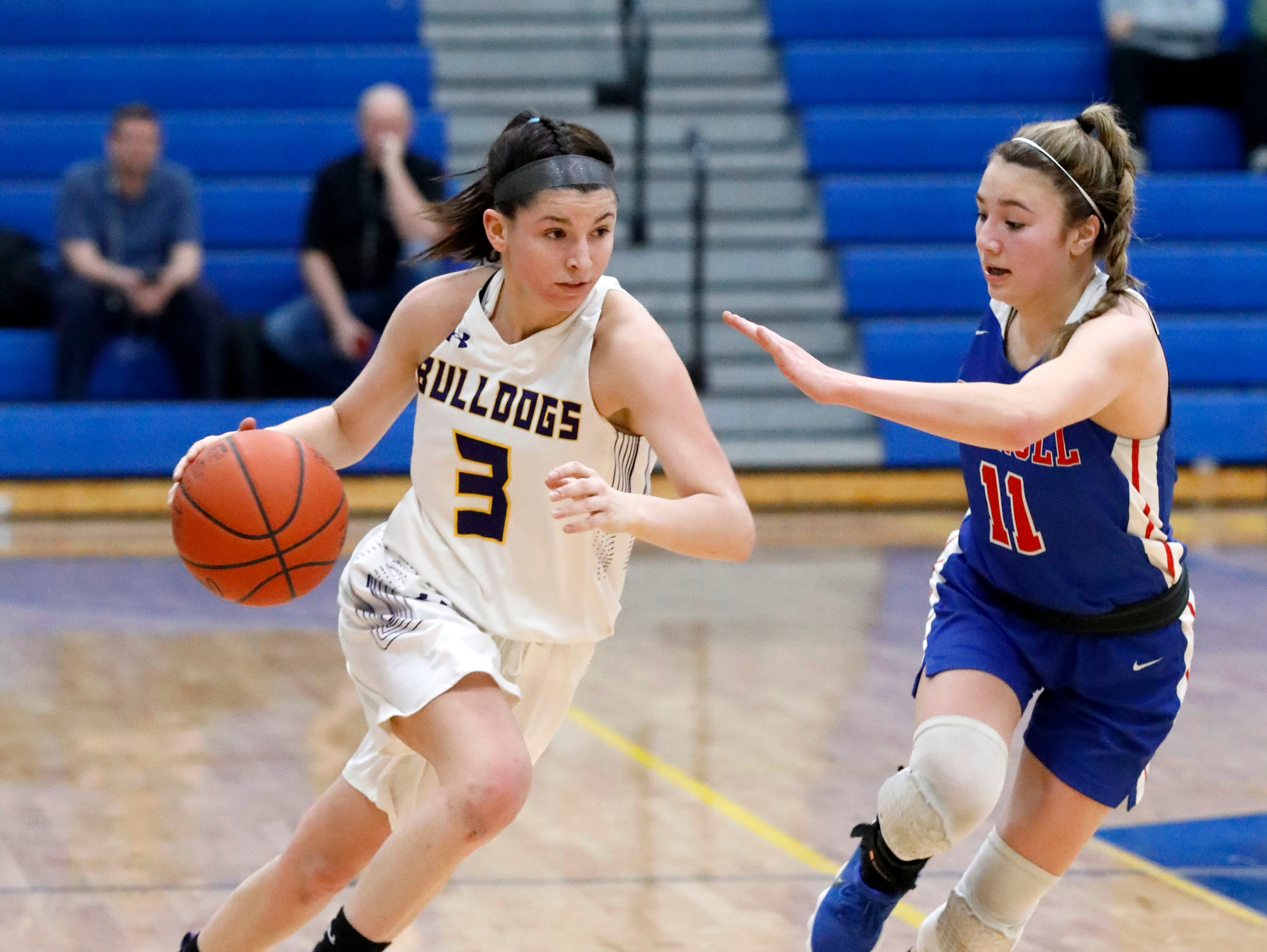 Bloom-Carroll's Makenzee Mason brings the ball down the court during Tuesday night's game, March 5, 2019, at Springfield High School in Springfield. The Bulldogs lost the game to Carroll 46-30.