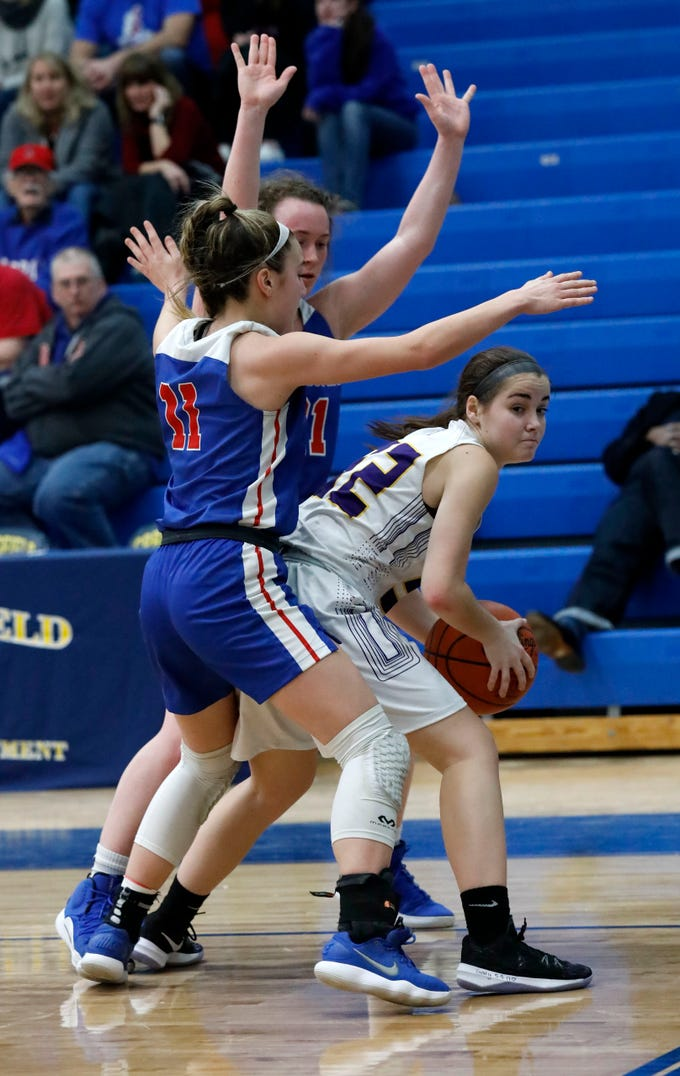 Bloom-Carroll's Nikki Bradbury looks for an open teammate during Tuesday night's game, March 5, 2019, at Springfield High School in Springfield. The Bulldogs lost the game to Carroll 46-30.