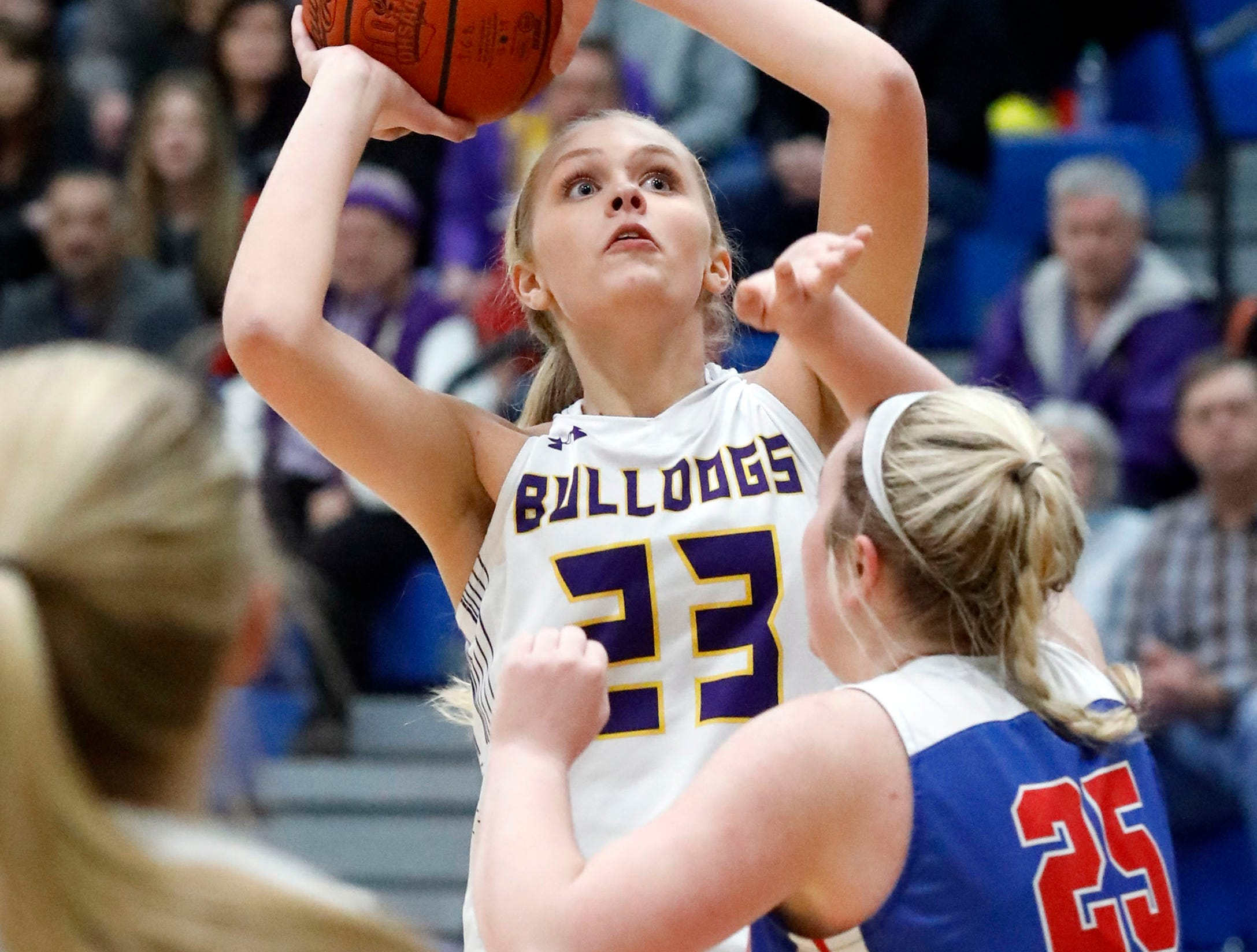 Bloom-Carroll's McKenzie Powers takes a host during Tuesday night's game, March 5, 2019, at Springfield High School in Springfield. The Bulldogs lost the game to Carroll 46-30.