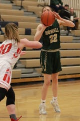 Howell's Maeve St. Johns takes a shot against Holly in a district basketball game on Wednesday, March 6, 2019.