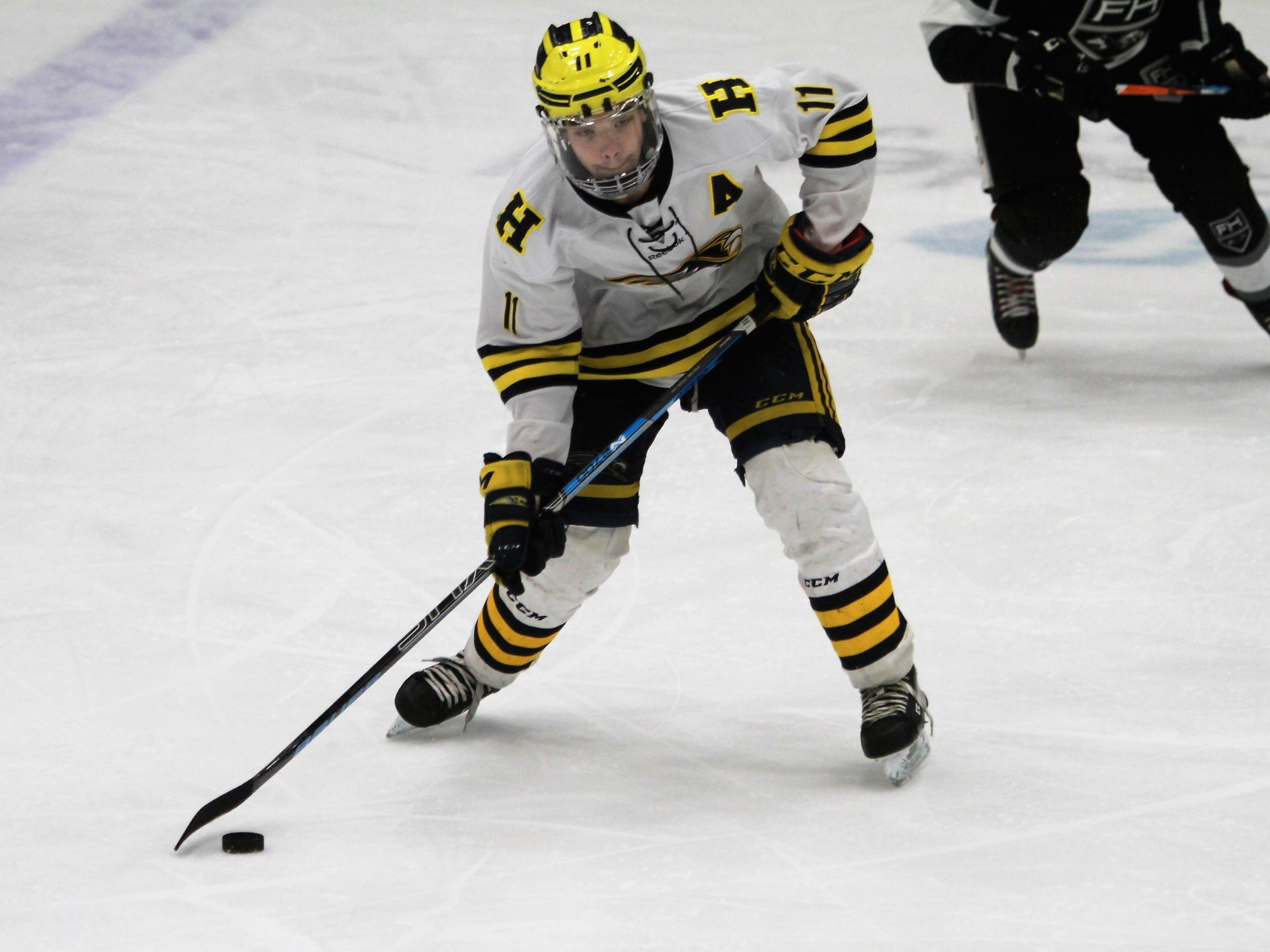 Hartland's Gabe Anderson, who scored the game's last goal, makes a pass during a 6-0 victory over Forest Hills Eastern in the state hockey quarterfinals on Tuesday, March 5, 2019.