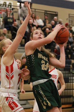 Howell's Meagan Tucker scored 15 of her 17 points in the first half of a 58-27 district basketball victory over Holly on Wednesday, March 6, 2019.