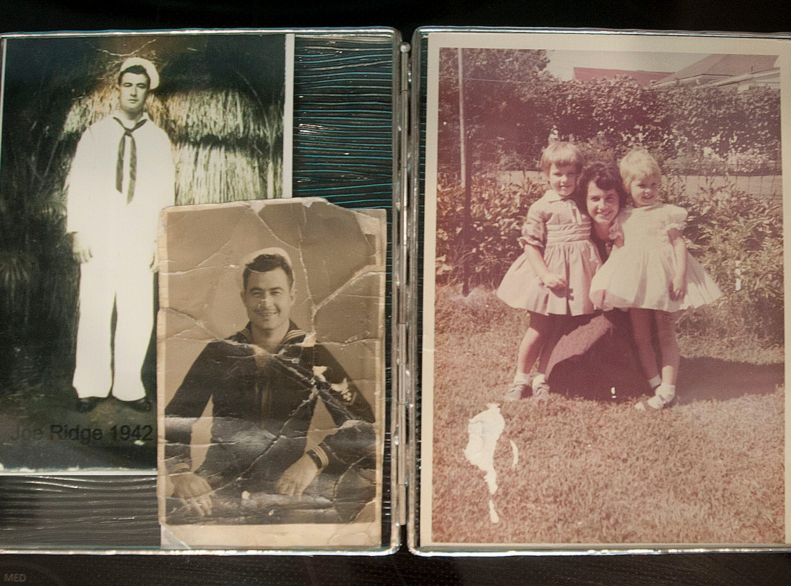 Atop the sewing machine are photos of Puthuff's grandfather, Joseph Ridge, when he joined the U.S. Navy in Hawaii in 1942, left, and during the Korean War, 1950, bottom right. At right is a photo of Puthuff's mother, Thelma Puthuff, holding Denise, left, and Denise's sister, Dianna, right.
