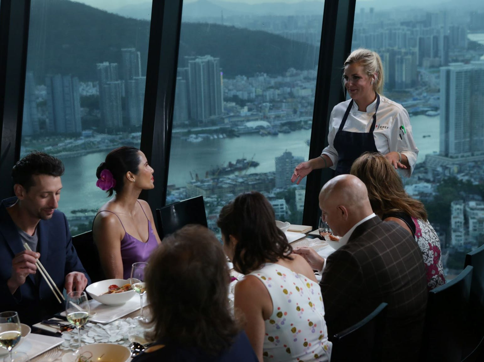 """Contestant Kelsey Barnard explains her dish to the judges on """"The Tao of Macau,"""" episode 14 of Bravo's 'Top Chef:' Kentucky season."""
