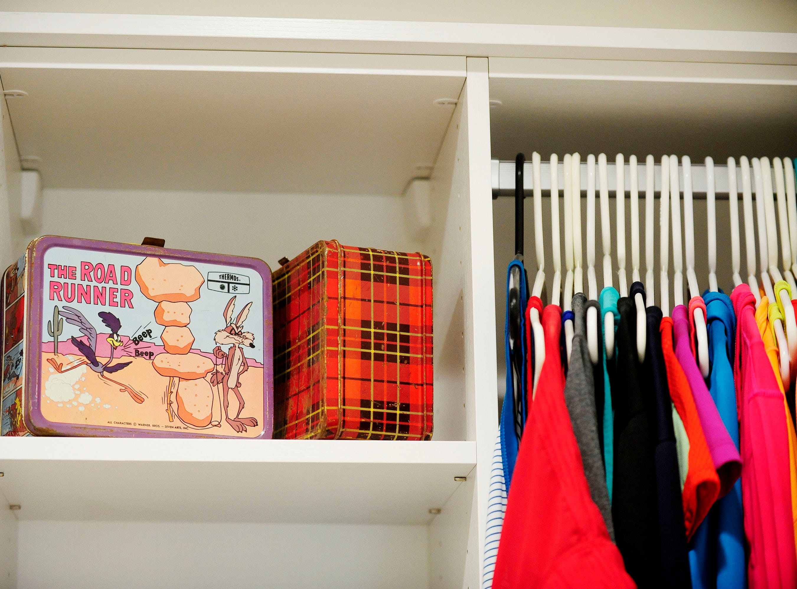 These childhood lunch boxes of Puthuff (at right) and her sister, Dianna (at left) help decorate the master bedroom walk-in closet.
