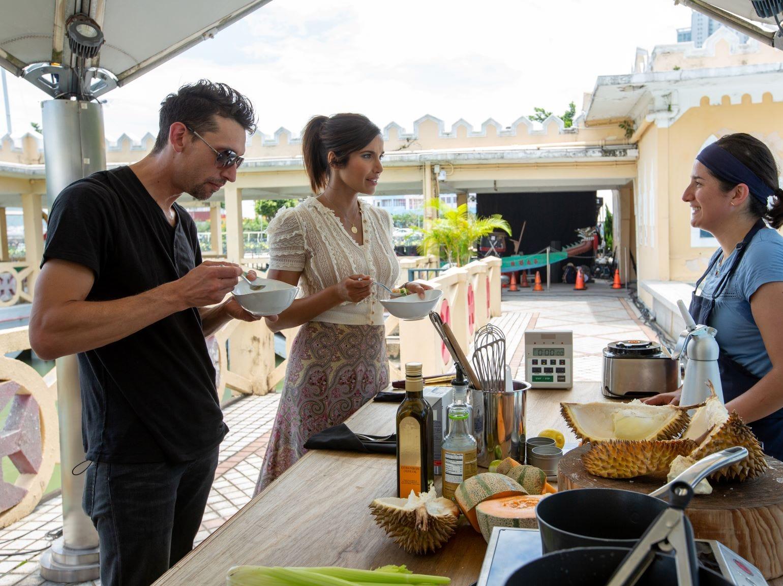"Guest Judge Abe Conlon and host Padma Lakshmi talk to contestant Michelle Minori about her dish on ""The Tao of Macau,"" episode 14 of Bravo's 'Top Chef:' Kentucky season."