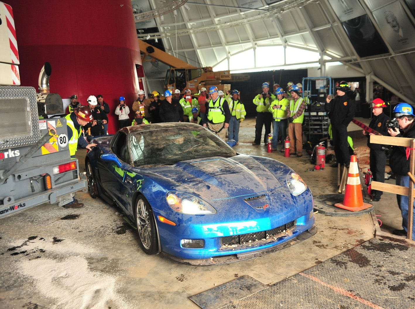 "The first corvette was pulled this morning from the sinkhole that engulfed the lobby of the National Corvette Museum in Bowling Green, Ky. The car was the 2009 ""Blue Devil"" ZR1 model.  There are seven more corvettes in the sinkhole that will be removed in the coming weeks."