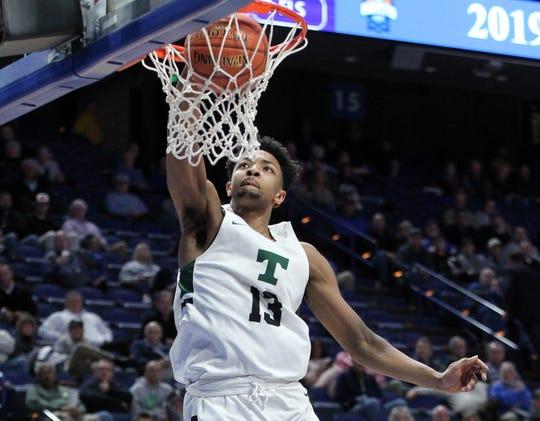 Louisville signee David Johnson throws down a dunk for Trinity High School.