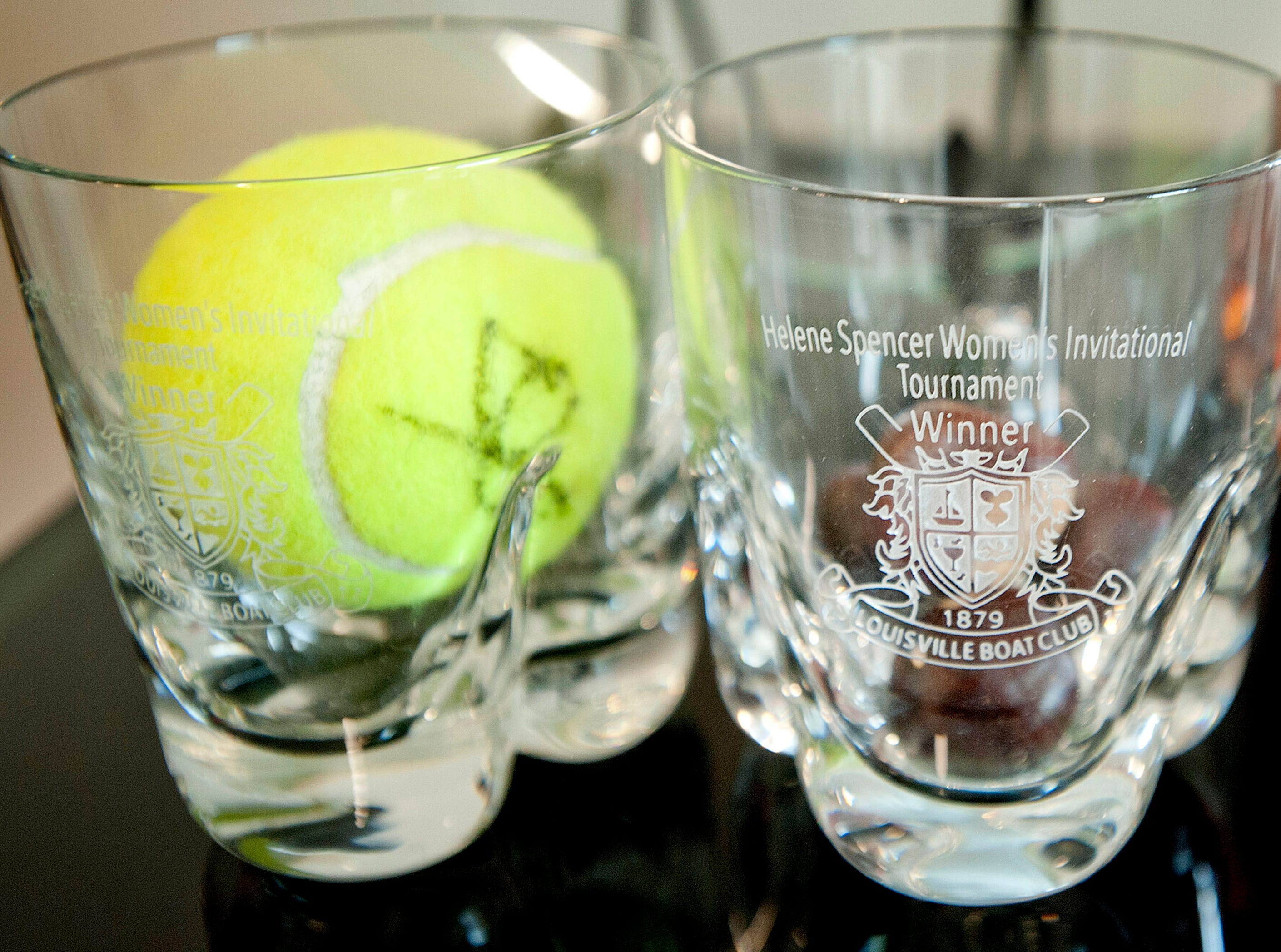 Puthuff and her sister are avid tennis players often teaming up in doubles tournaments. Among the trophies in the living room is this glass trophy they got for winning the Helene Spencer Invitational Tennis Tournament doubles championship sponsored by the Louisville Boat Club  19 February 2019