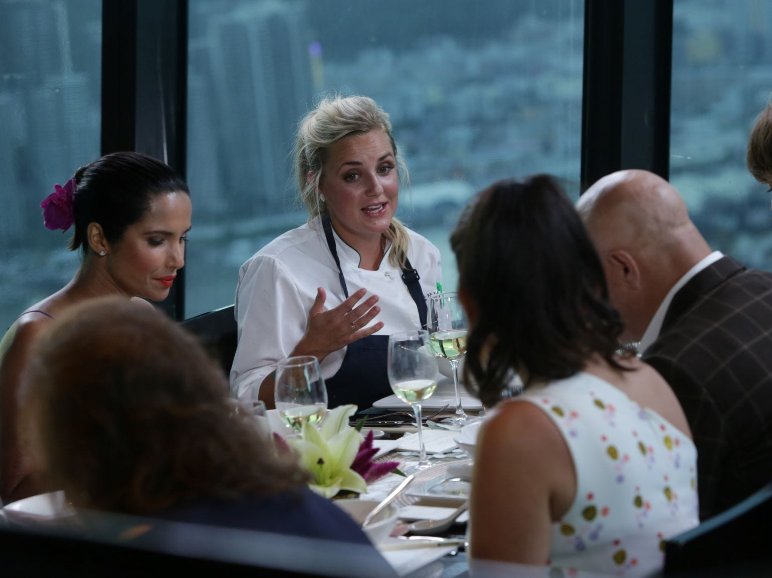"""(From left to right): Padma Lakshmi listens as contestant Kesley Barnard talks about her dish on """"The Tao of Macau,"""" episode 14 of Bravo's 'Top Chef:' Kentucky season."""
