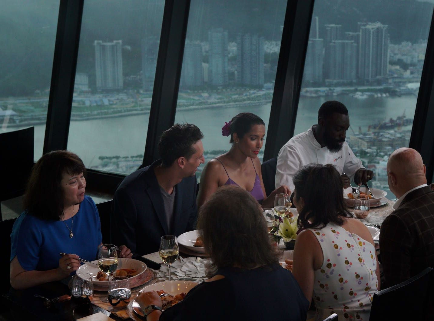 """Contestant Eric Adjepong dines with the judges on """"The Tao of Macau,"""" episode 14 of Bravo's 'Top Chef:' Kentucky season."""