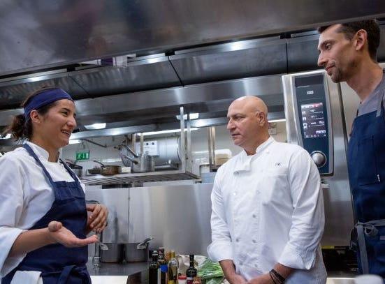 "Contestant Michelle Minori talks to judges Tom Colicchio and Abe Conlon on ""The Tao of Macau,"" episode 14 of Bravo's 'Top Chef:' Kentucky season."