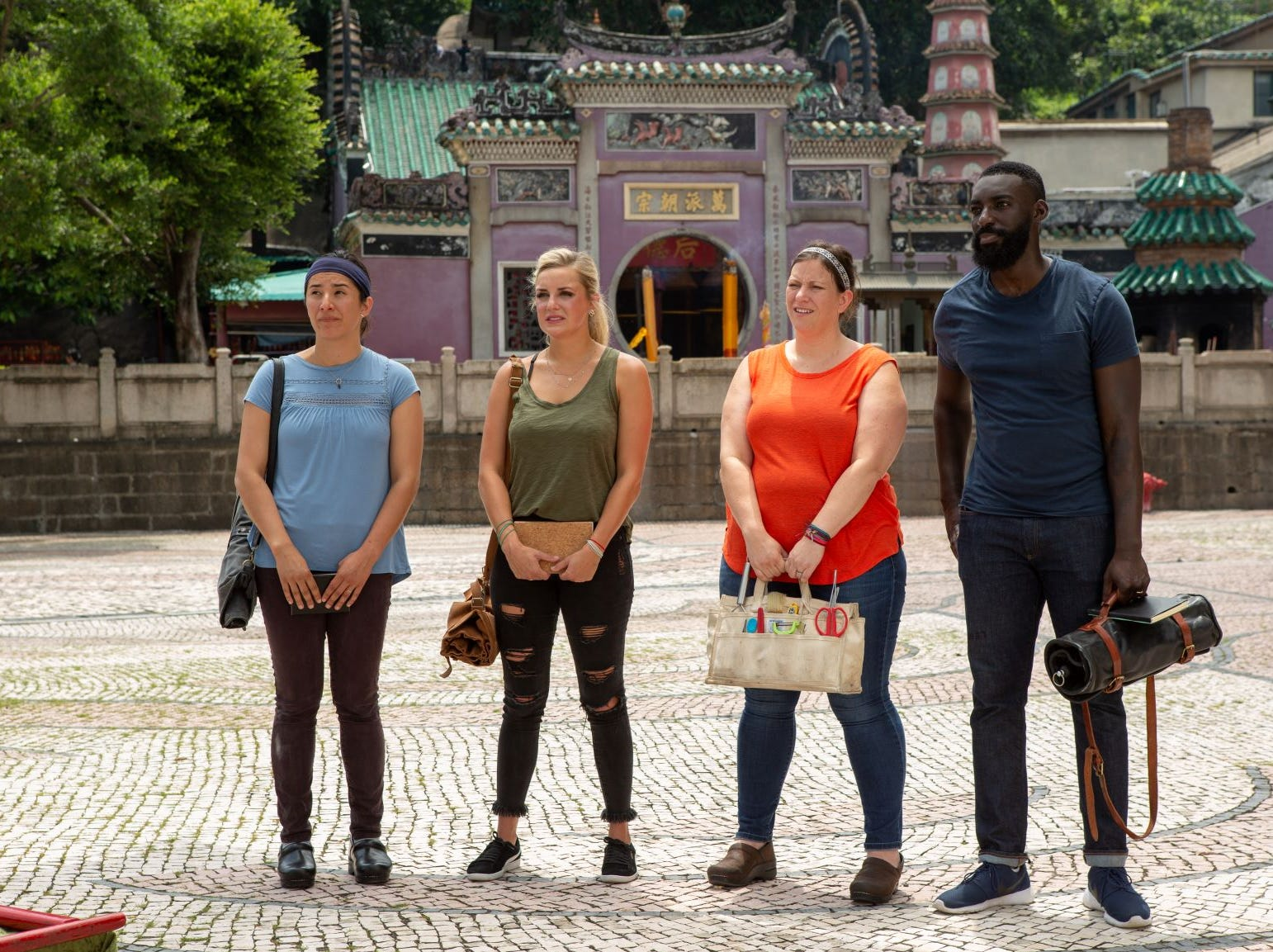 "(From left to right): Contestants Michelle Minori, Kelsey Barnard, Sara Bradley and Eric Adjepong on ""The Tao of Macau,"" episode 14 of Bravo's 'Top Chef:' Kentucky season."