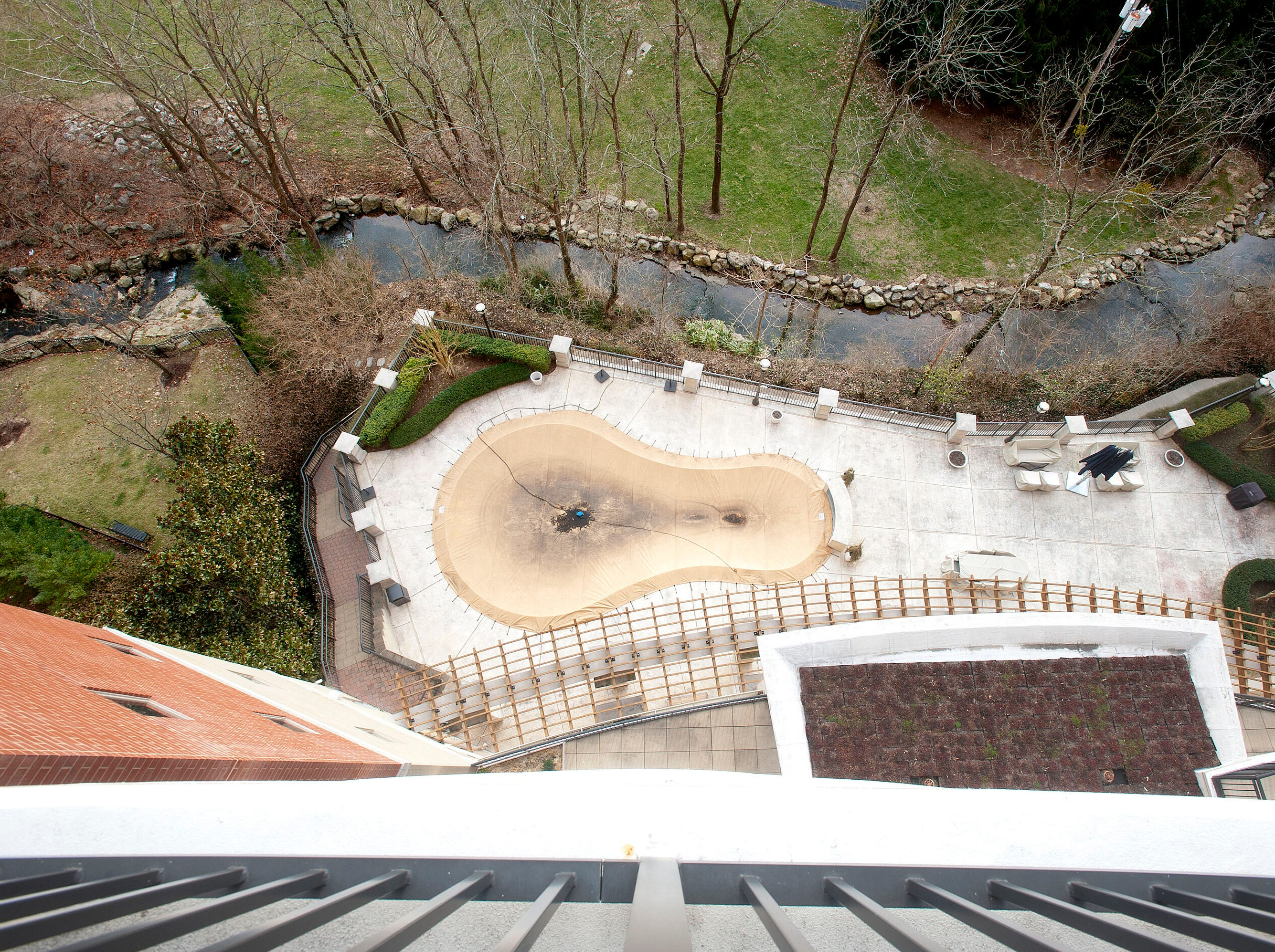 A view of a brook and The George's swimming pool from the balcony in the Denise Puthuff's unit.